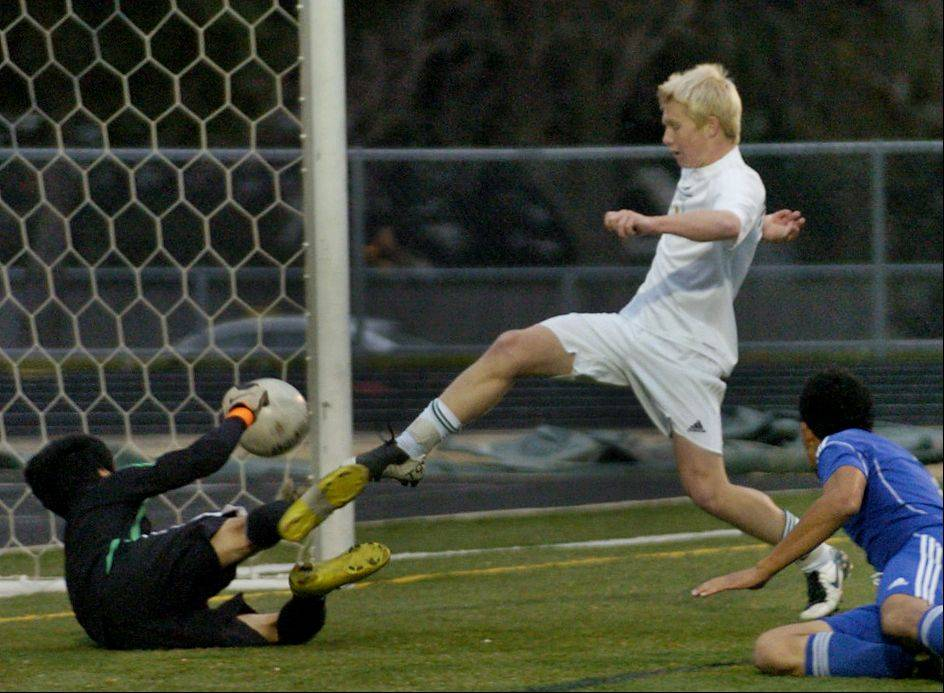 Eric Leonard of Fremd scores the first goal of the game during Tuesday's soccer regional semifinal against Wheeling.
