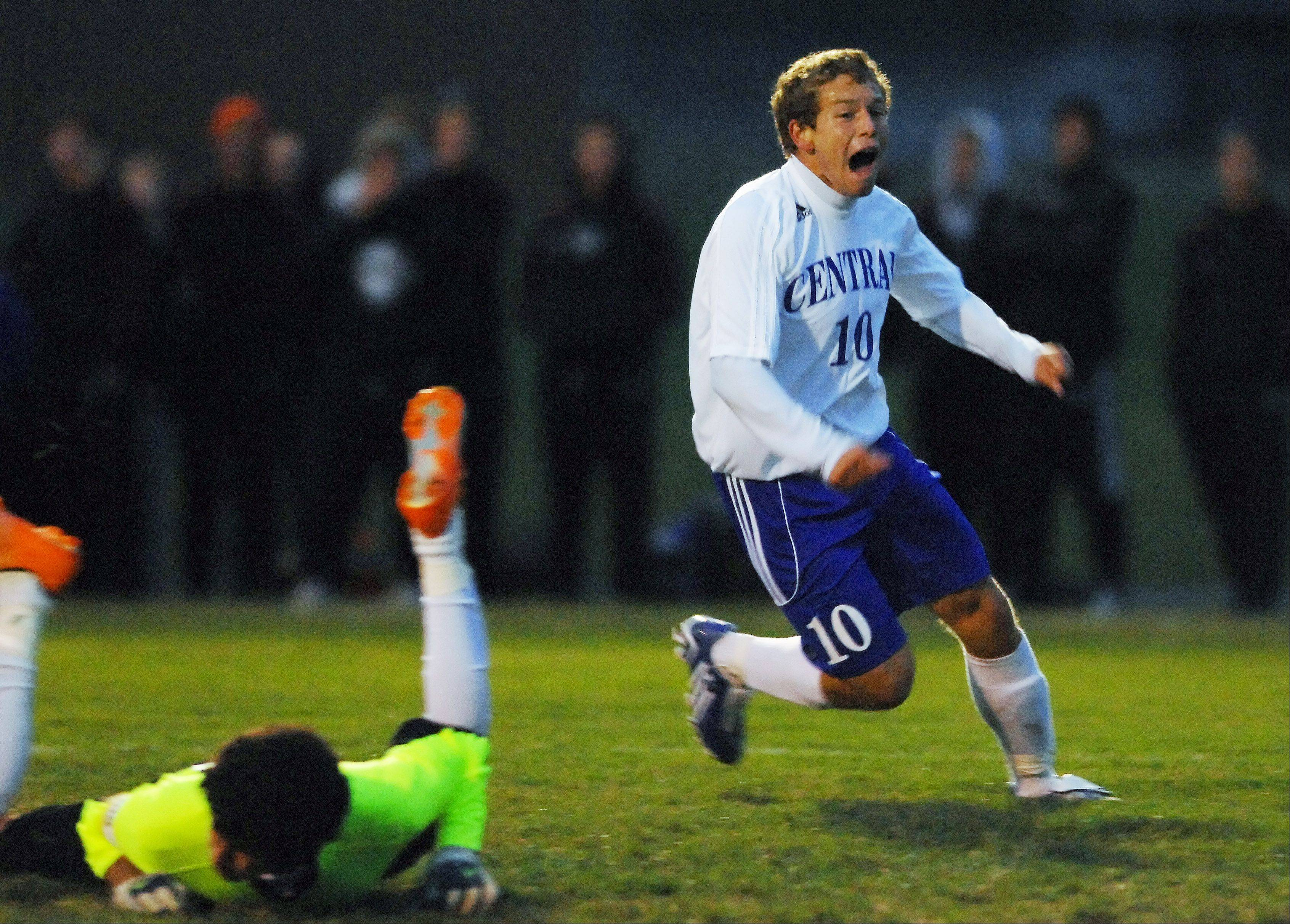 Burlington Central's Chris Gousios celebrates a goal in front of Marengo goalkeeper Sergio Orozco during the Hampshire soccer regional game Tuesday. It was Gousios' first of three goals.