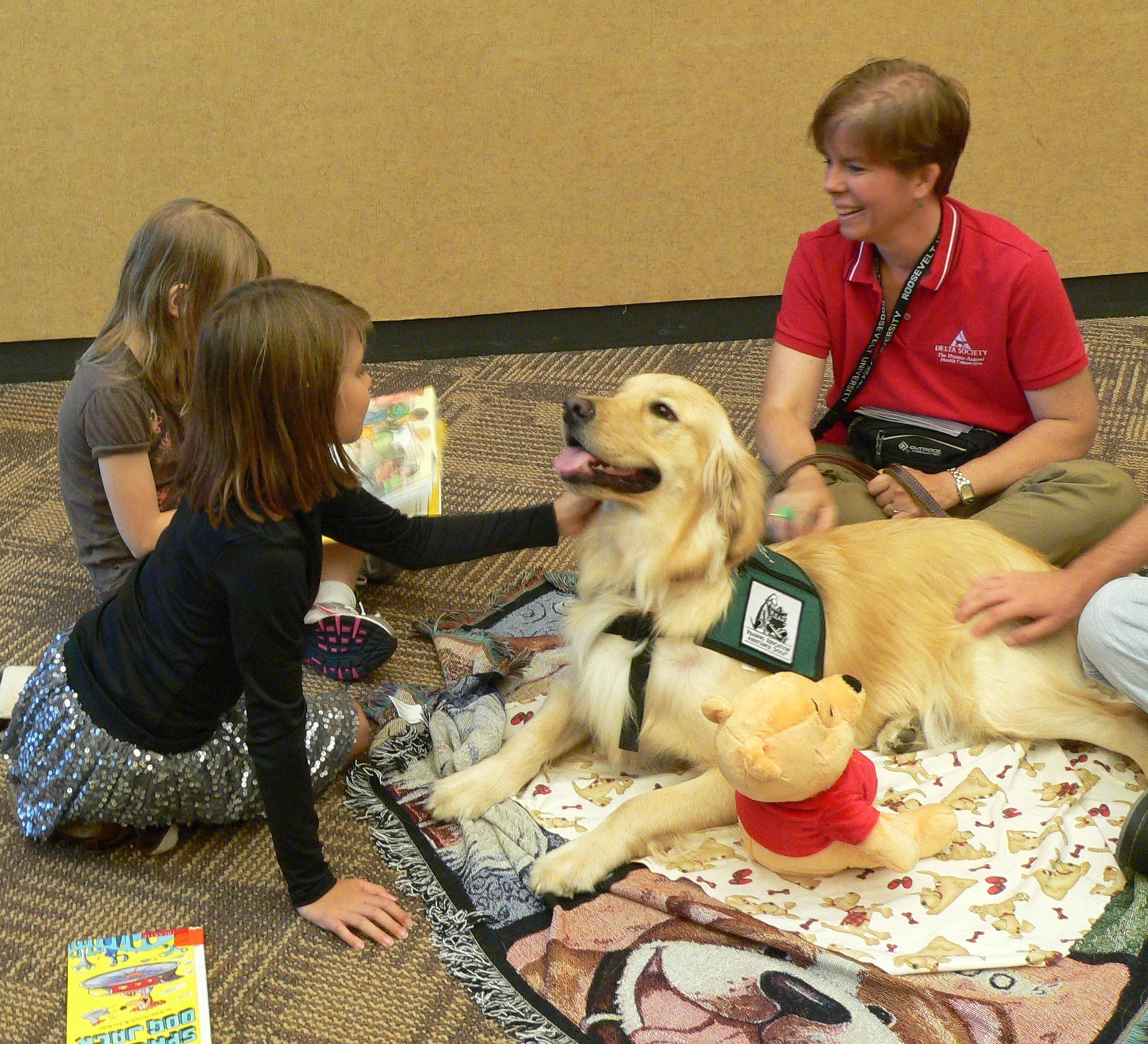 "The ""Bark for Books"" reading program pairs students in first through third grades with dogs to read to. Sessions are scheduled Nov. 12 through the Naperville Public Library."