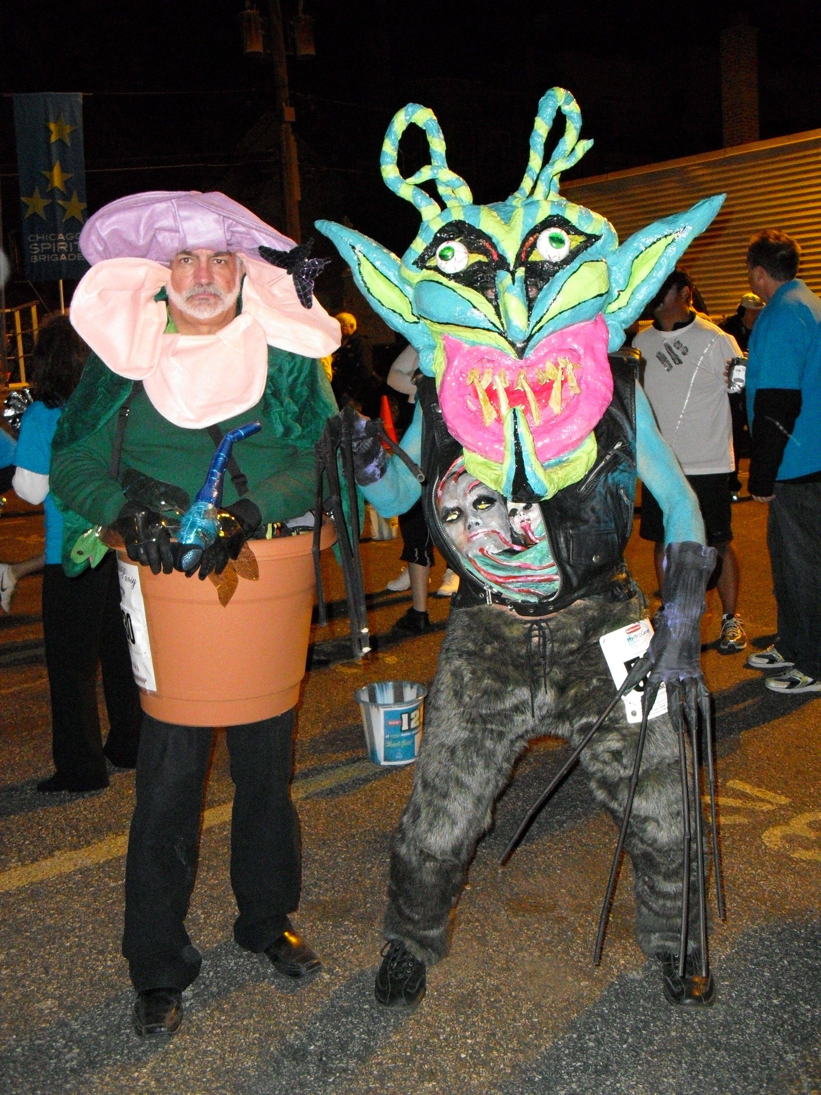 A self-watering plant and a horrific creature at the 2010 North Halsted Street Halloween Parade.