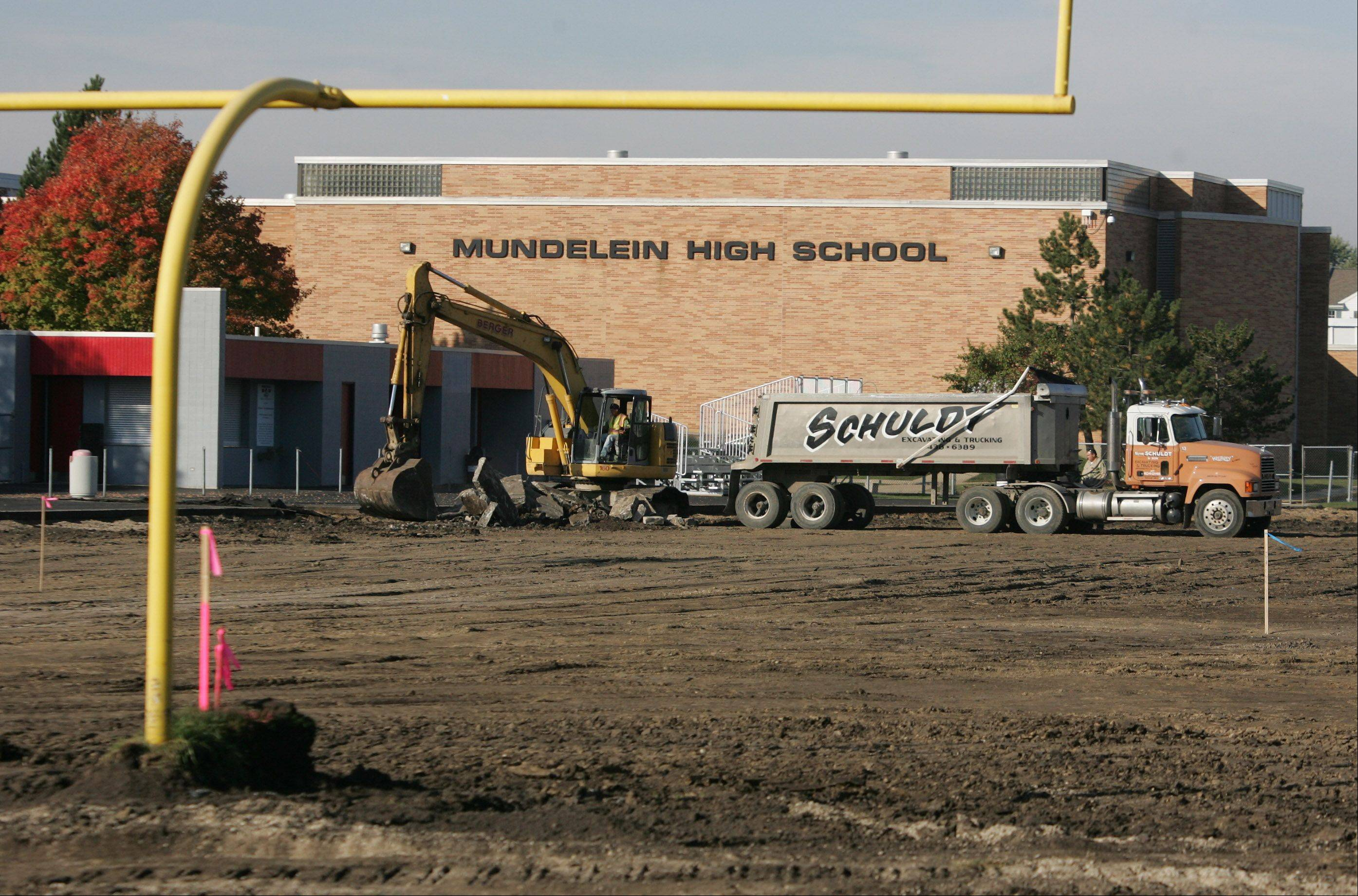 Mundelein High School's grass football field has been torn up to make way for an artificial playing surface that will be ready for play in 2012.