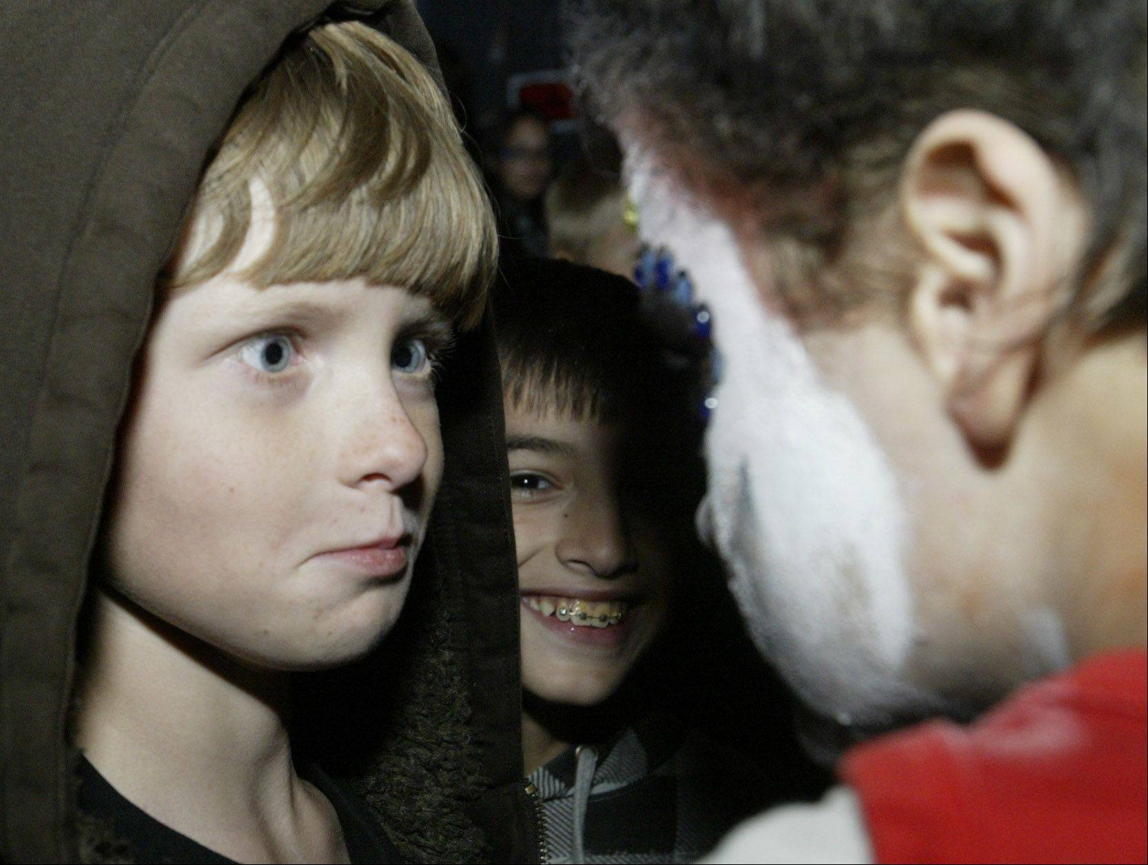 Keith Hurley, 11, of Pingree Grove stares at a zombie at the Burden Acres Haunted Hike Friday in Elgin. The haunted hike is offered by Three Fires Council Boy Scouts.