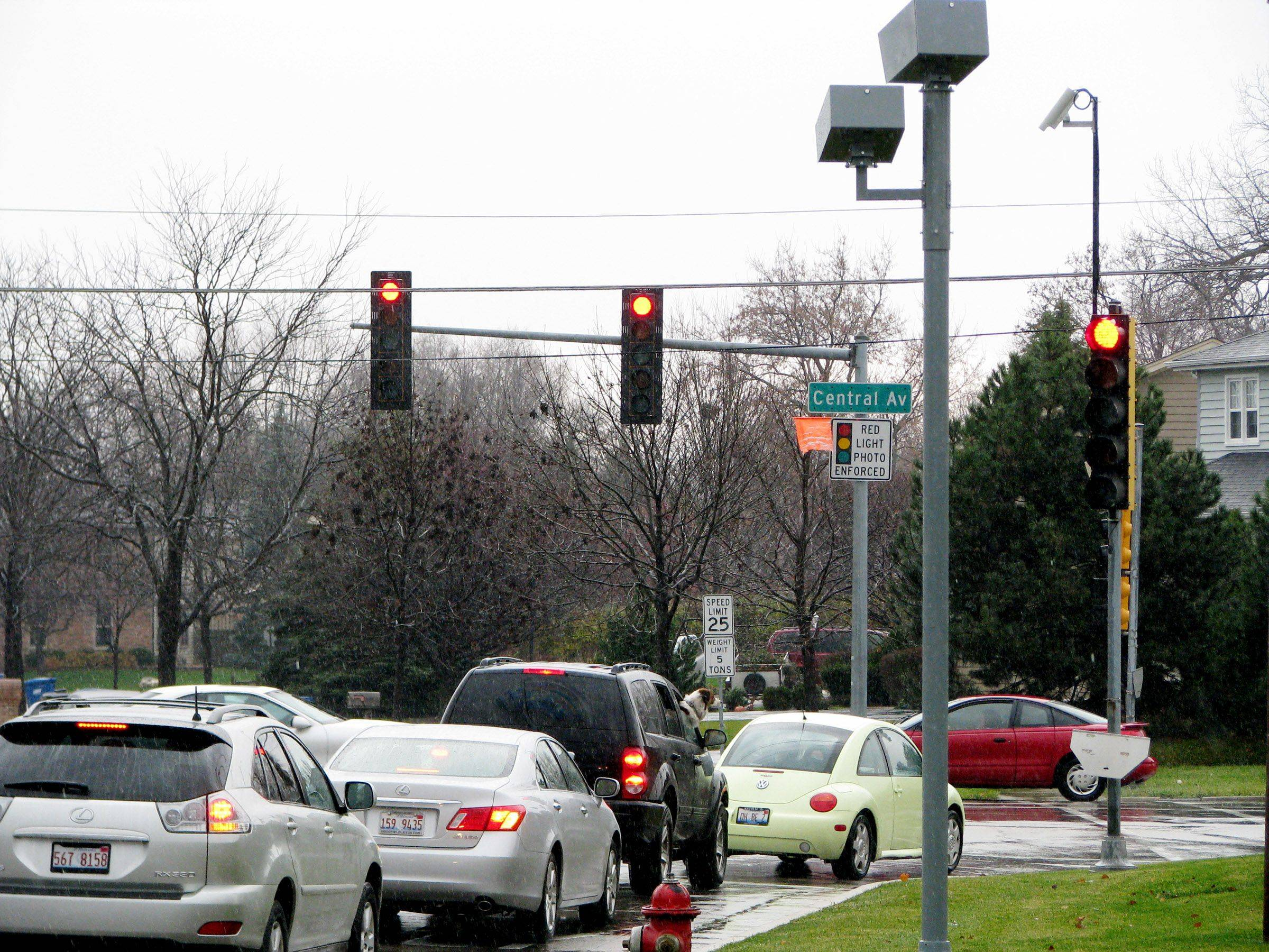 A new report looks at issues involving red-light cameras.