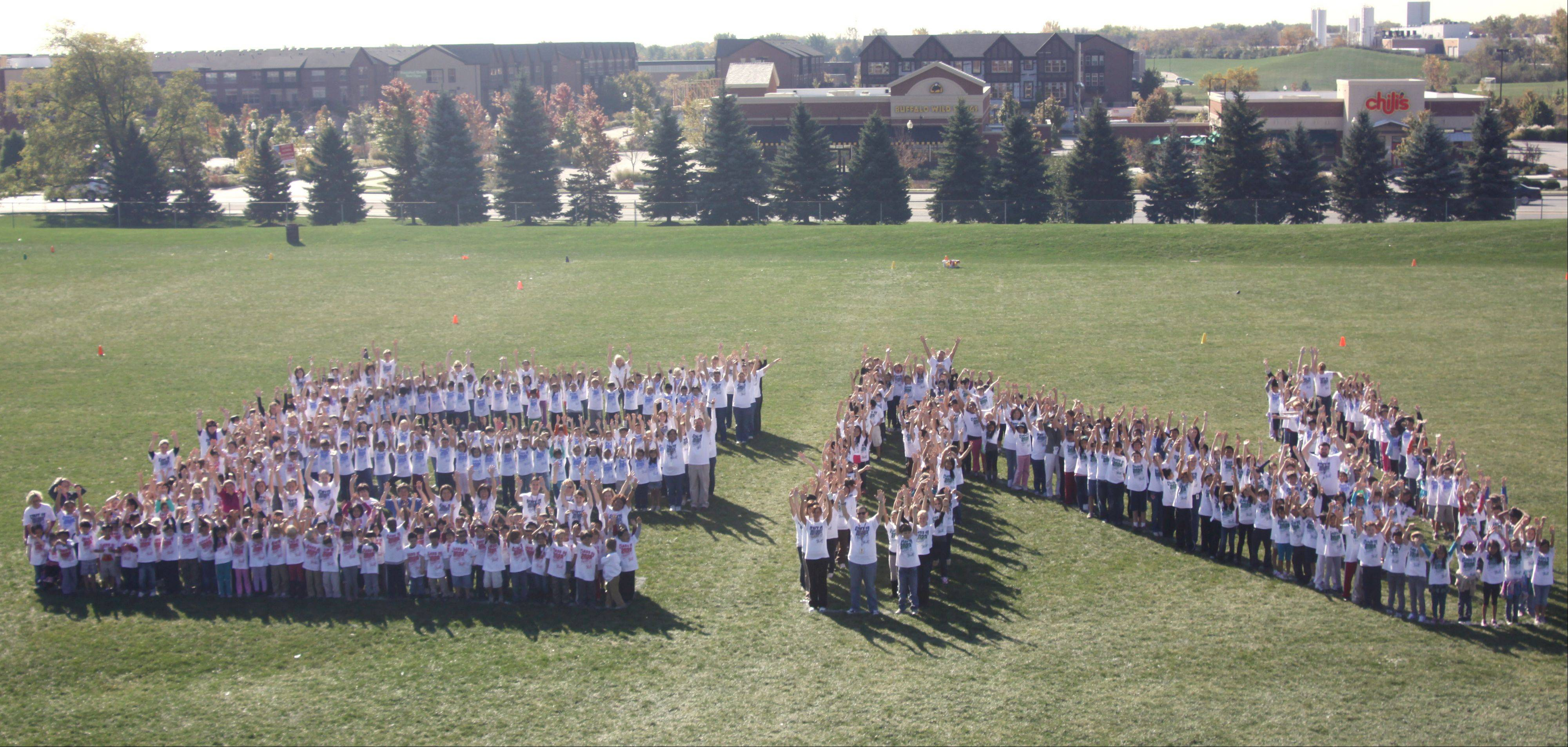 Hawthorn Elementary North students spell out the initials of their school in Vernon Hills.