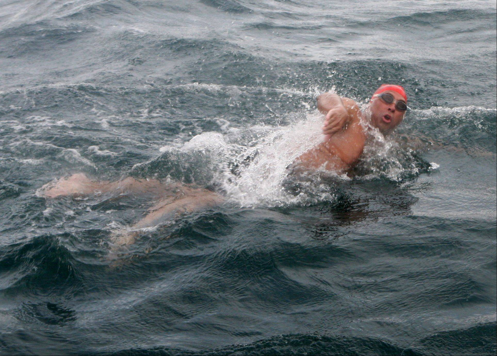 Doug McConnell of Barrington in the midst of his conquering of the English Channel Aug. 22 to raise money for the Les Turner ALS Foundation.