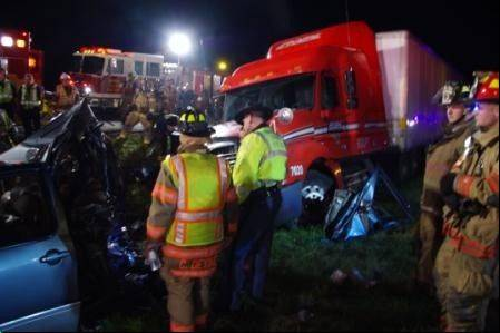 A tractor-trailer slammed into the back of a minivan in northern Indiana killing at least seven people and sending four others to hospitals, authorities said.