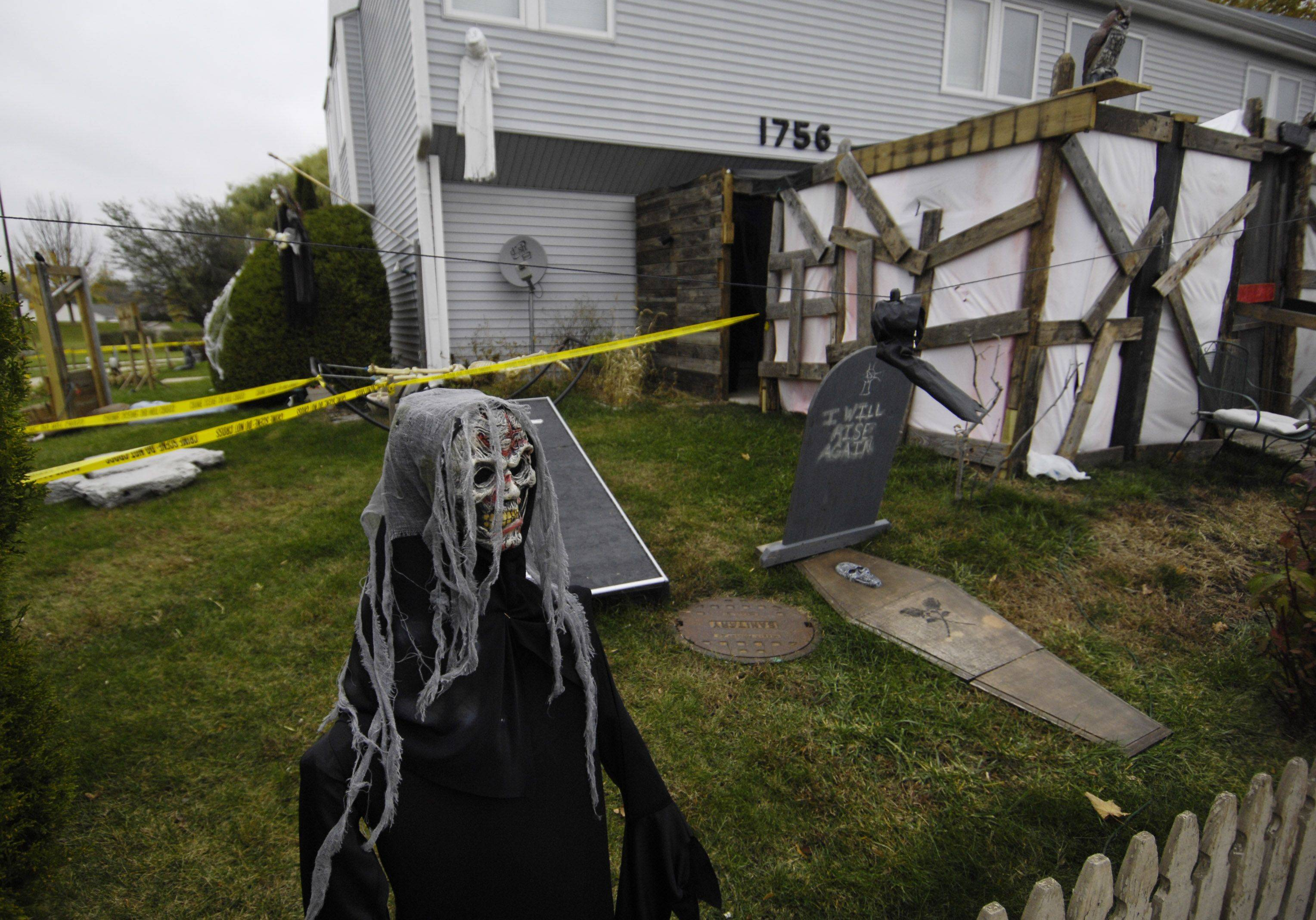 "The Jon Gear home at 1756 Cumberland Green Drive in St. Charles has Halloween decorations in the front and side yards, as well as a neighbor's patio. Gear won ""high scare _ low budget"" in the St. Charles Park District's contest."