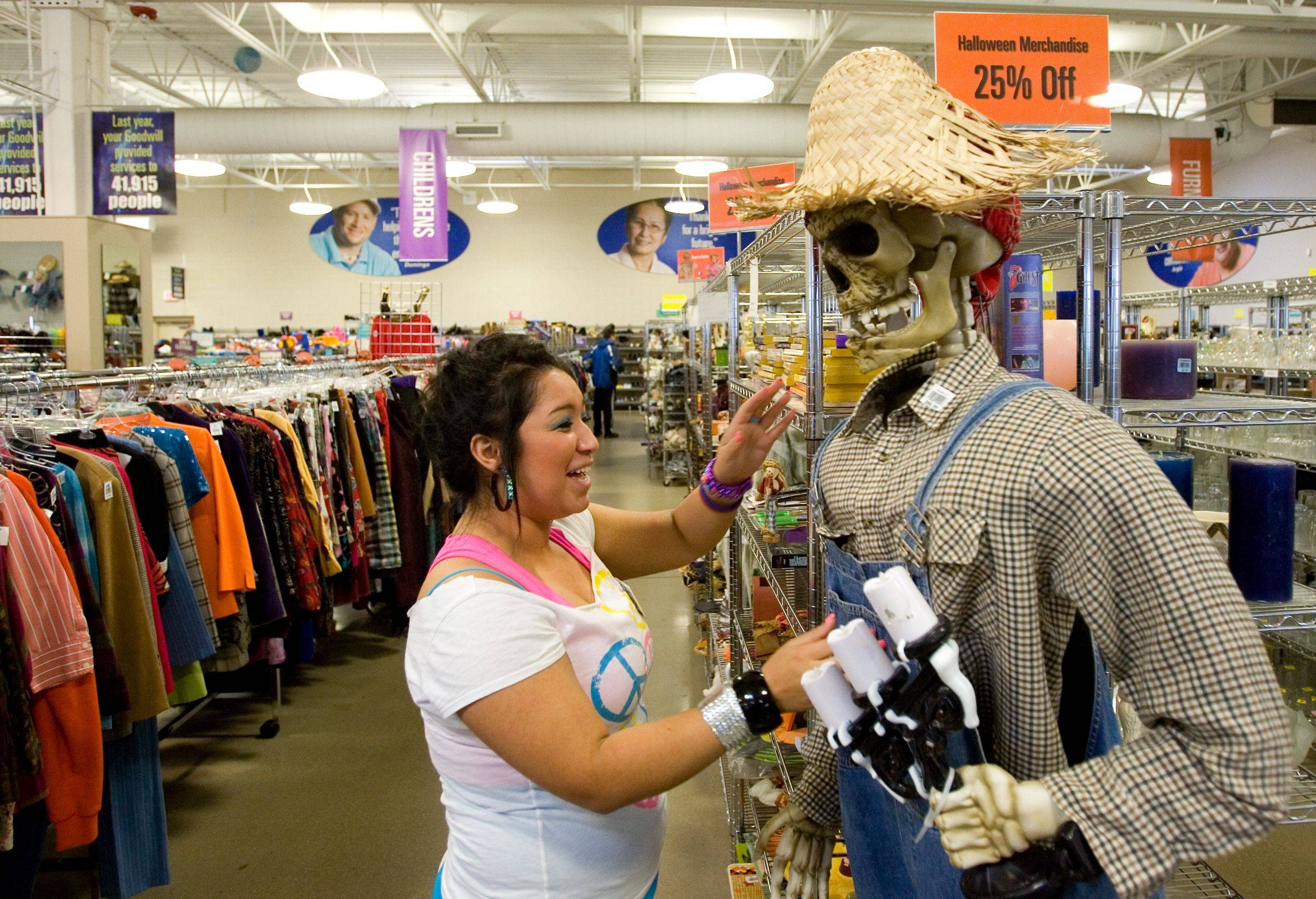 Rosa Olivares organizes Halloween decorations at the Goodwill store on North Avenue in Glendale Heights.