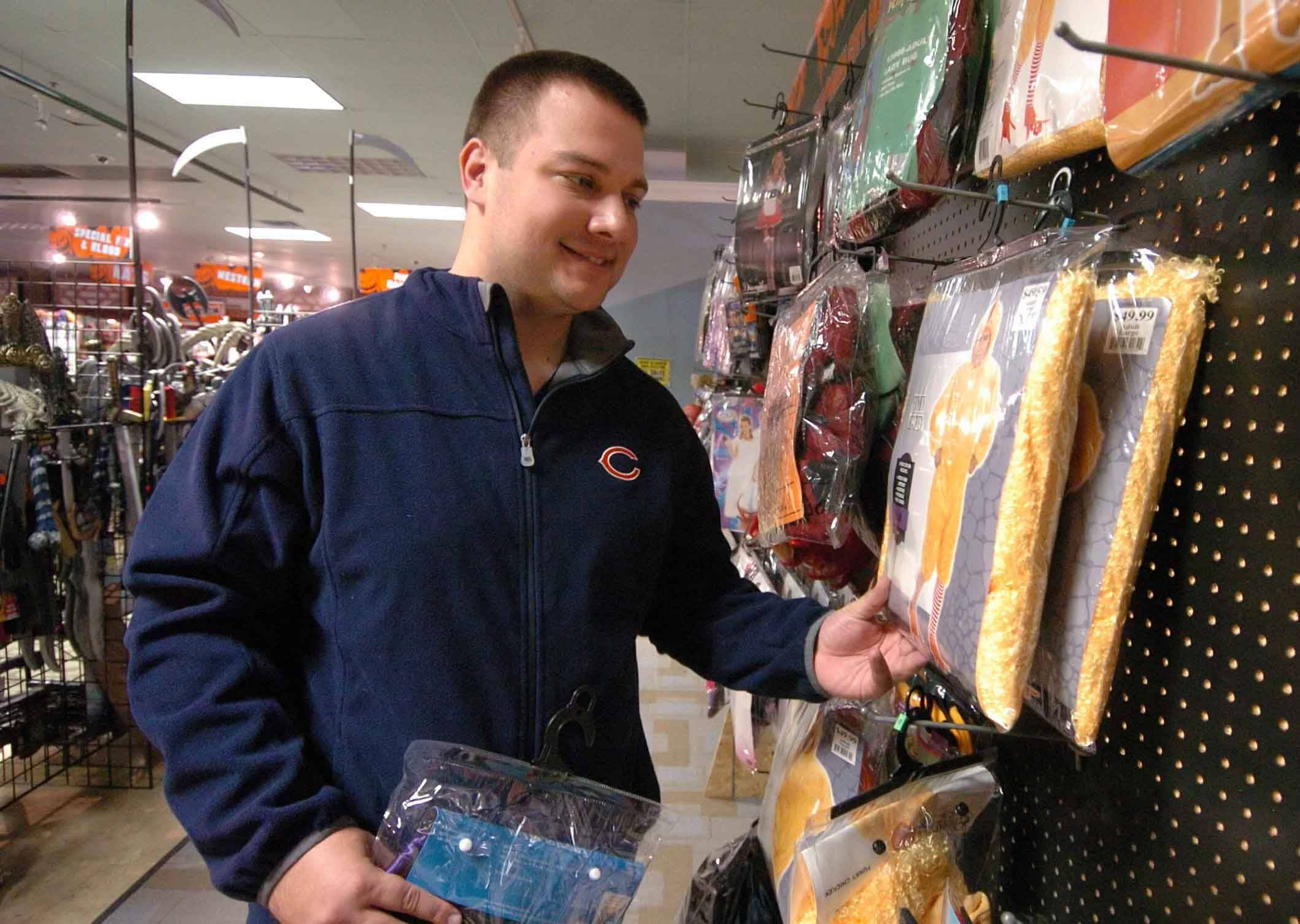 Matt Smetko of Aurora shops for his costume at Halloween City in Downers Grove.