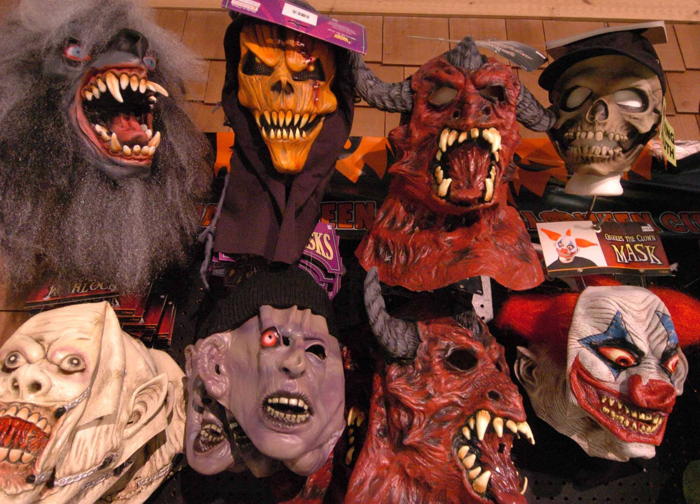 Masks line the walls at Halloween City in Downers Grove on Thursday, but the store soon gets swamped and costumes dwindle in the days leading up to Halloween.