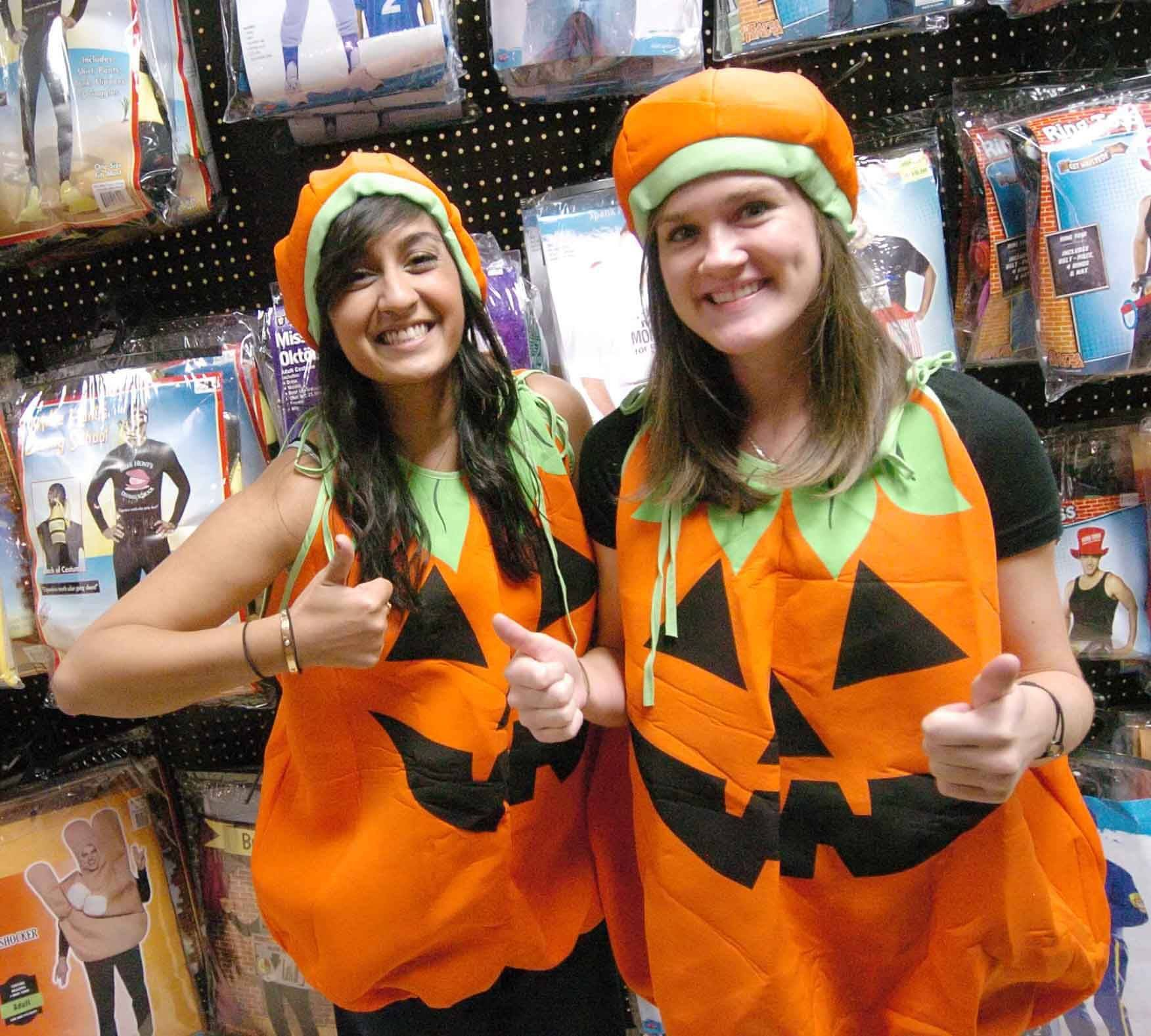 Ashley Shah, left, and Dana Koenig of Lombard opt for pumpkin costumes.