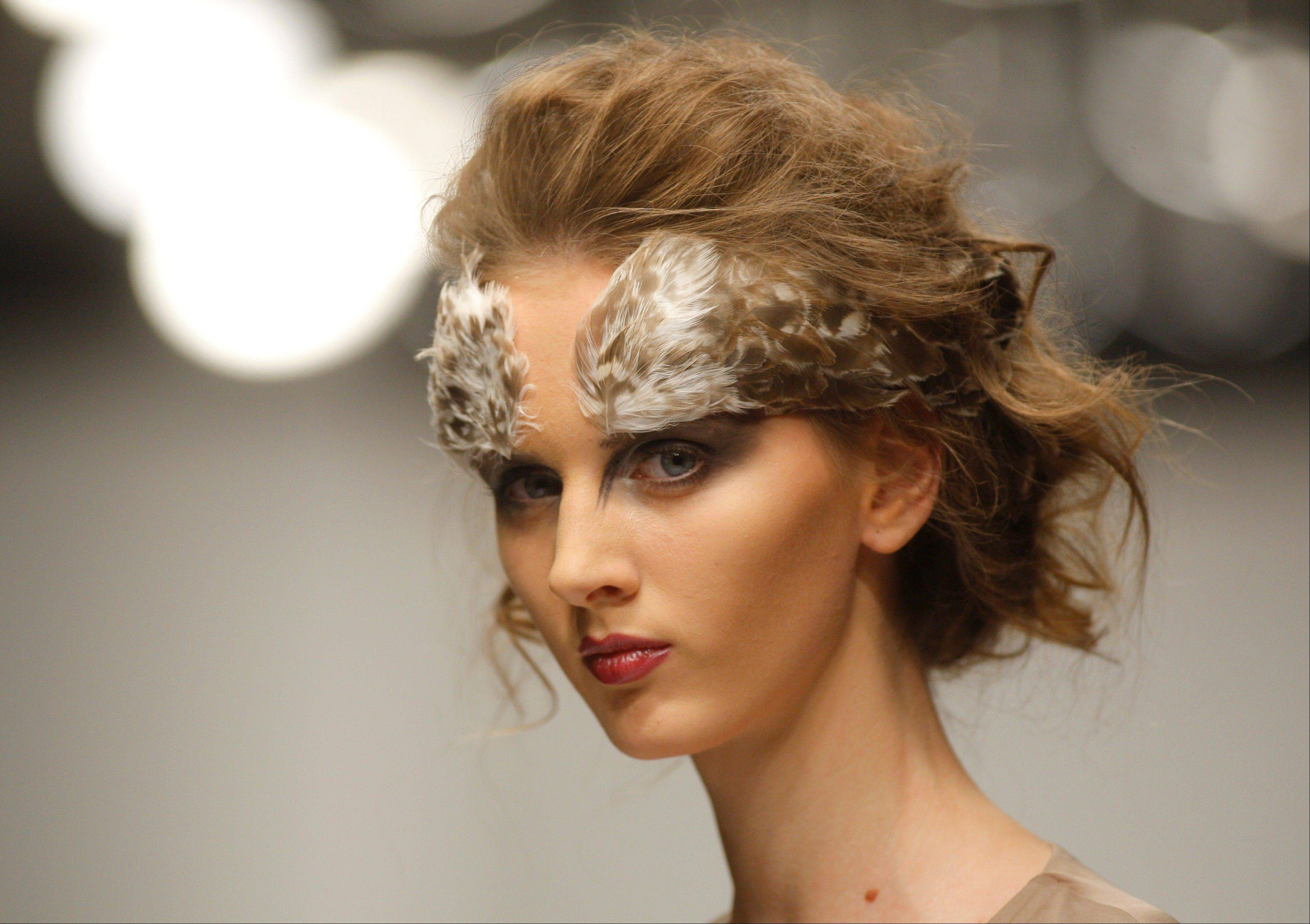 A model presents a creation by designer Yulia Latushkina during Belarus Fashion Week in Minsk, Belarus, Sunday, Oct. 23, 2011.