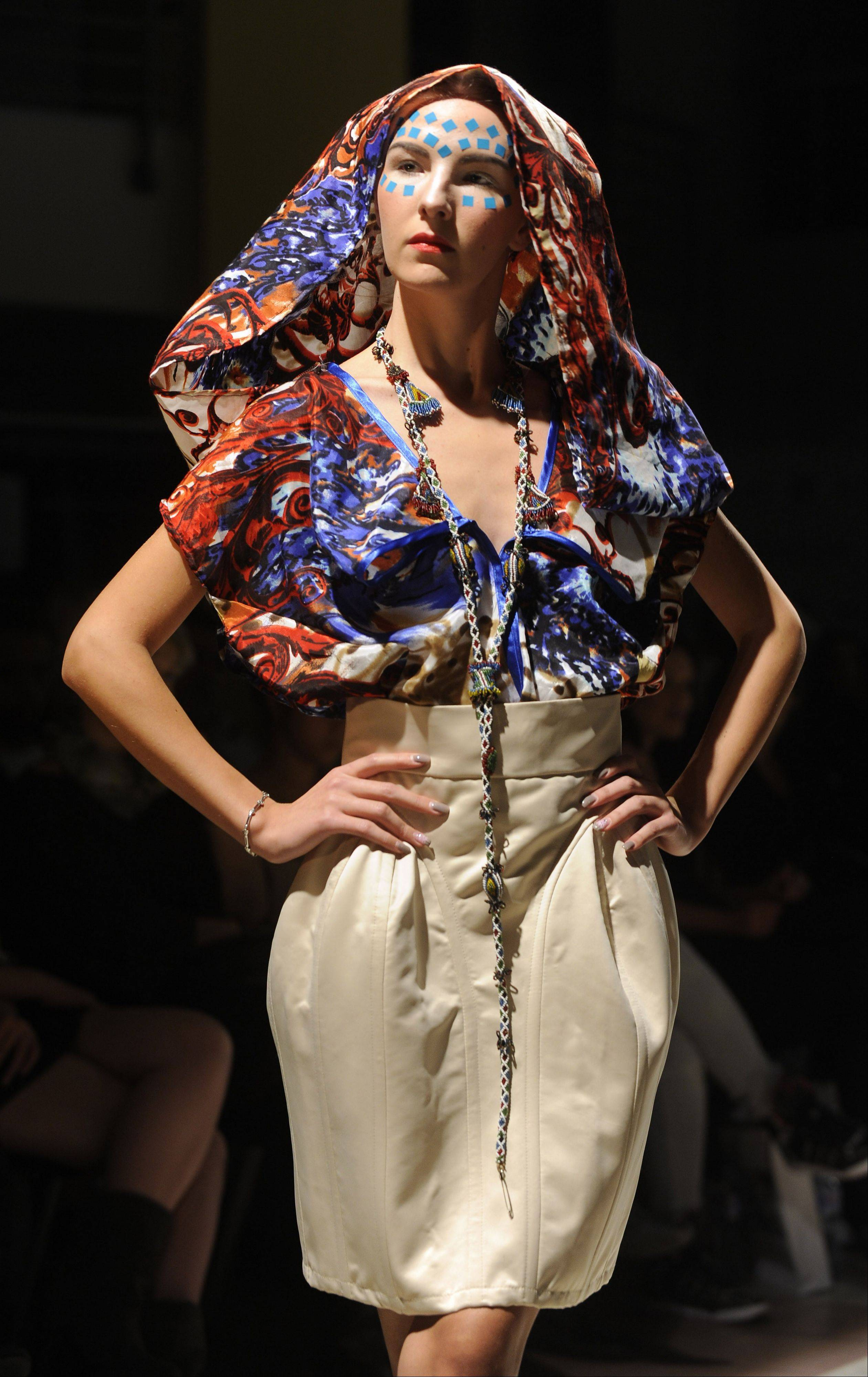 A model displays a creation of Macedonian fashion designer Olgica Gjorgieva, during Skopje Fashion Weekend show in Macedonia's capital Skopje, Sunday, Oct. 23, 2011.