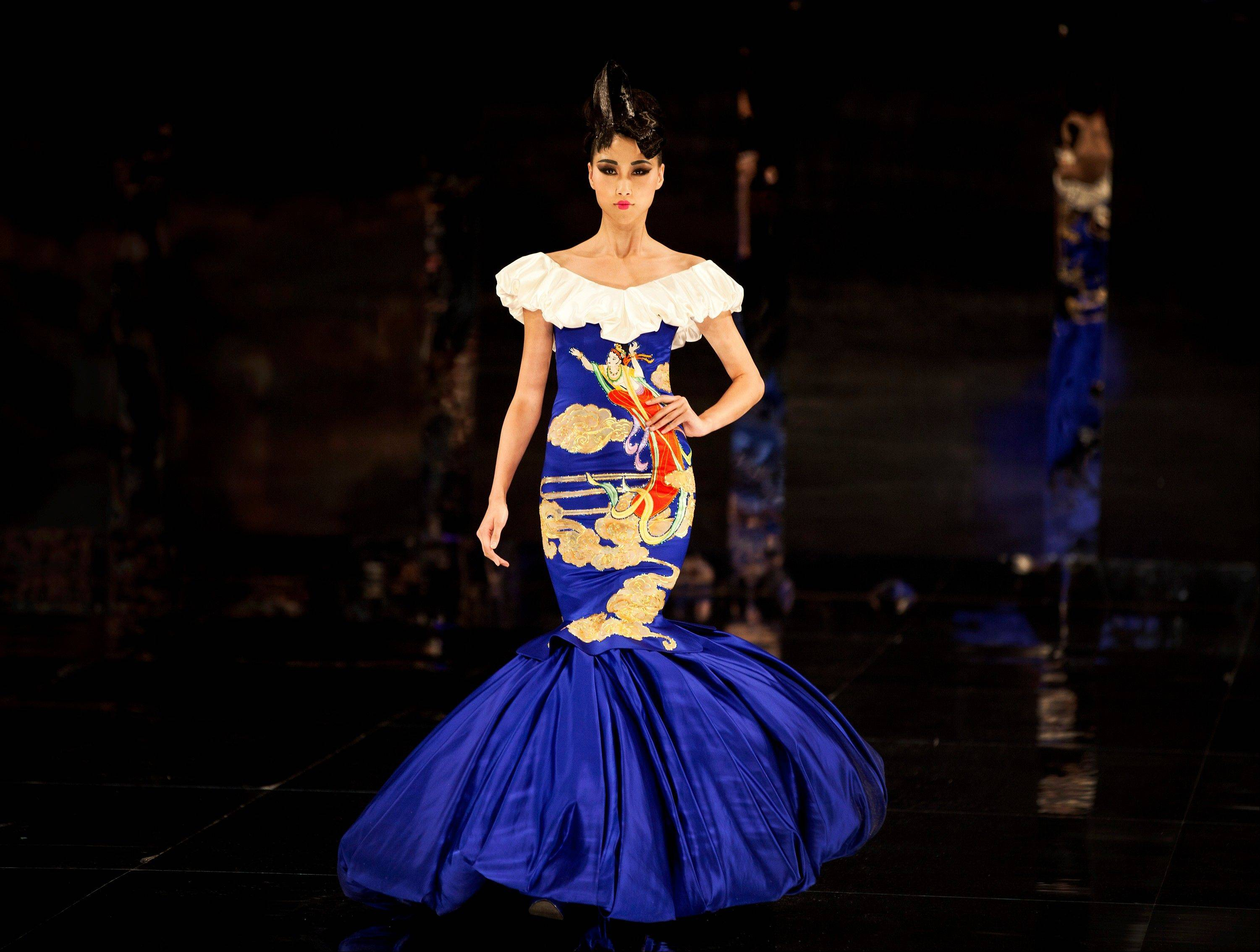 "A model presents a creation by NE TIGER Couture 2012 collection with the theme ""Tang Dynasty"" during China Fashion Week for Spring/Summer 2012 in Beijing, China, Tuesday, Oct. 25, 2011."