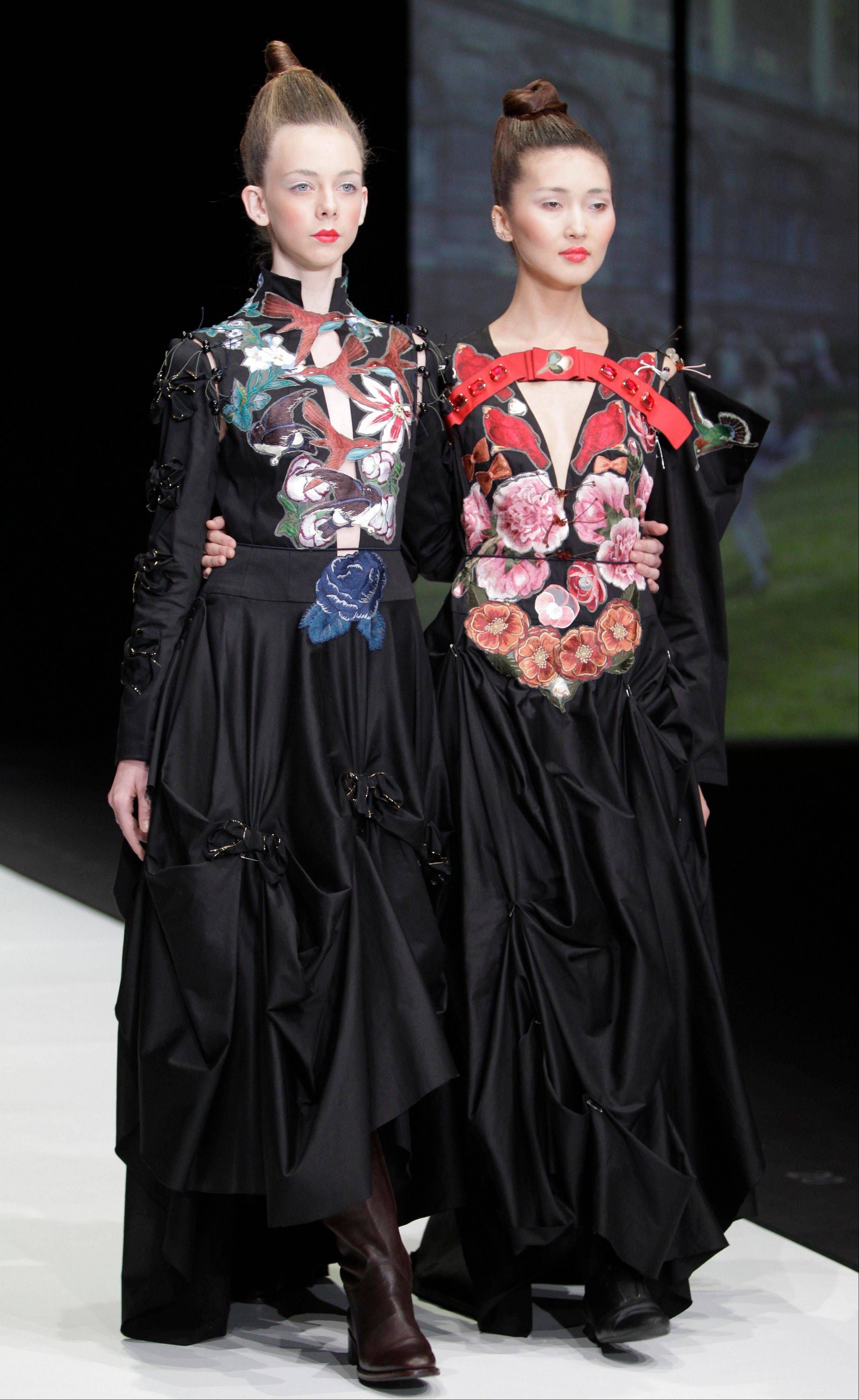 Models display creations by Russian designer Tatiana Parfionova for her Spring-Summer 2012 collection during Fashion Week in Moscow, Russia, Monday, Oct. 24, 2011.