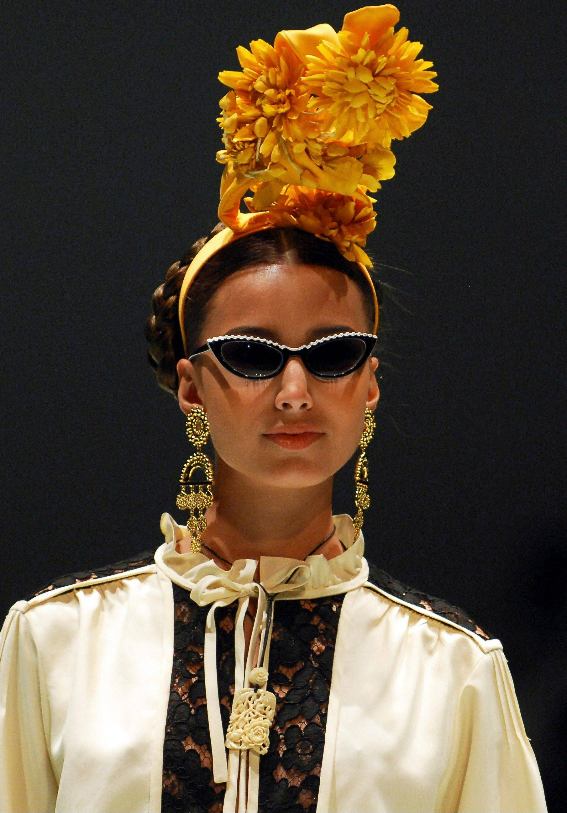 A model wears a creation part of the Moschino women's Spring-Summer 2012 collection at the Cali Exposhow fashion week in Cali, Colombia, Thursday, Oct. 20, 2011.