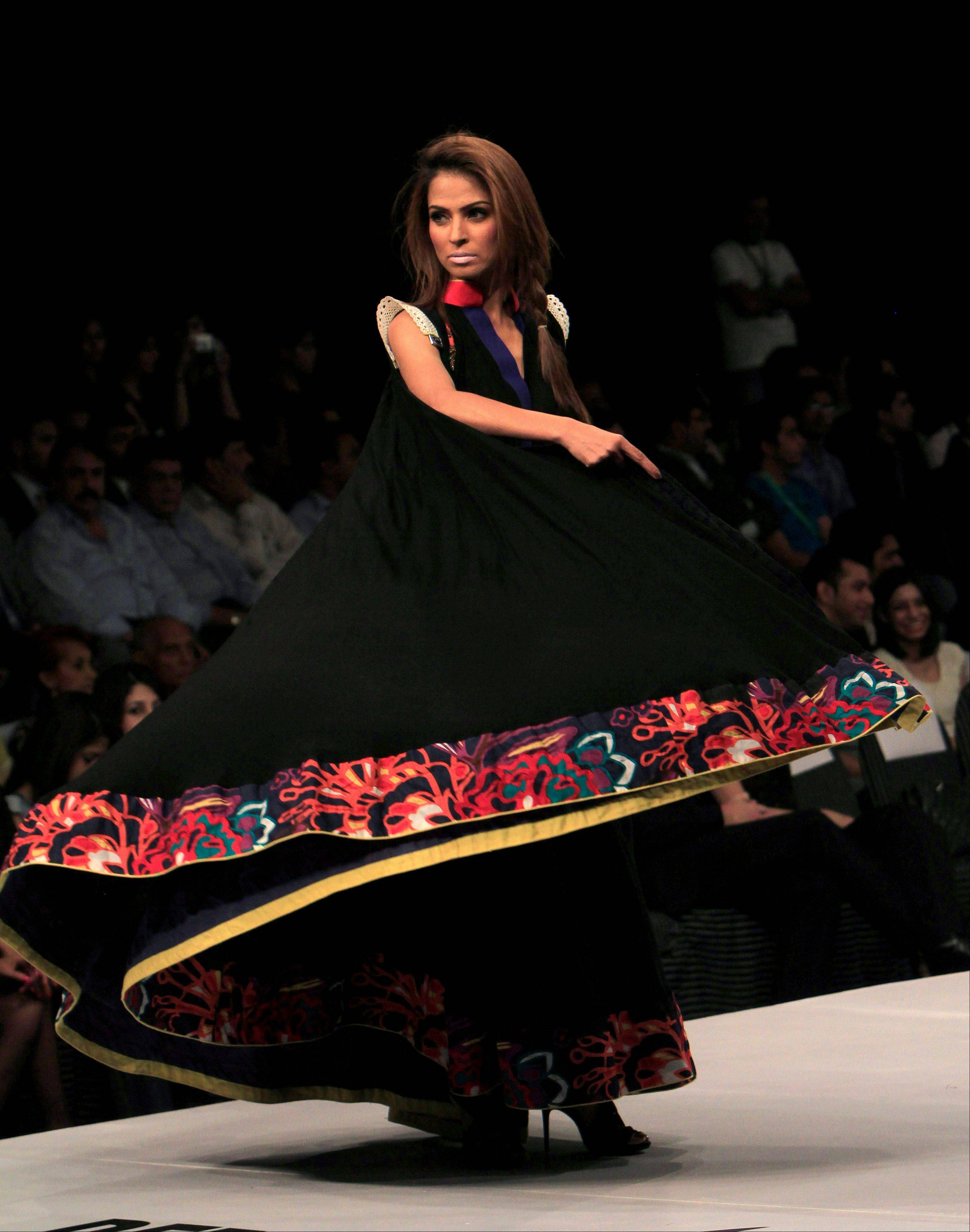 A model presents a creation of a Pakistani designer M Irfan Ali during a fashion show in Karachi, Pakistan on Friday, Oct. 21, 2011.