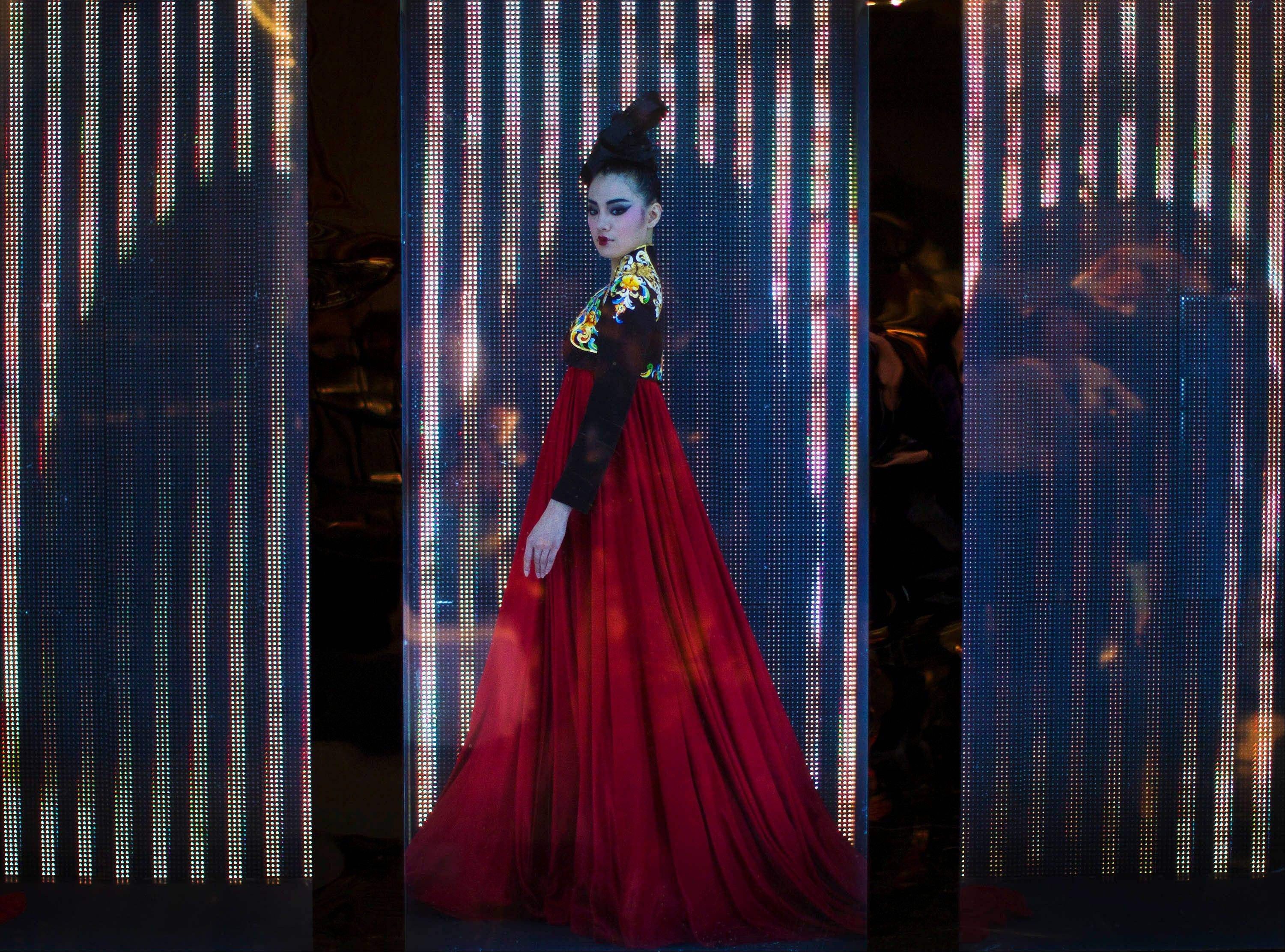 "A model displays a Couture 2012 creation designed by NE TIGER with the theme ""Tang Dynasty"" during China Fashion Week for Spring/Summer 2012 in Beijing, China, Tuesday, Oct. 25, 2011."