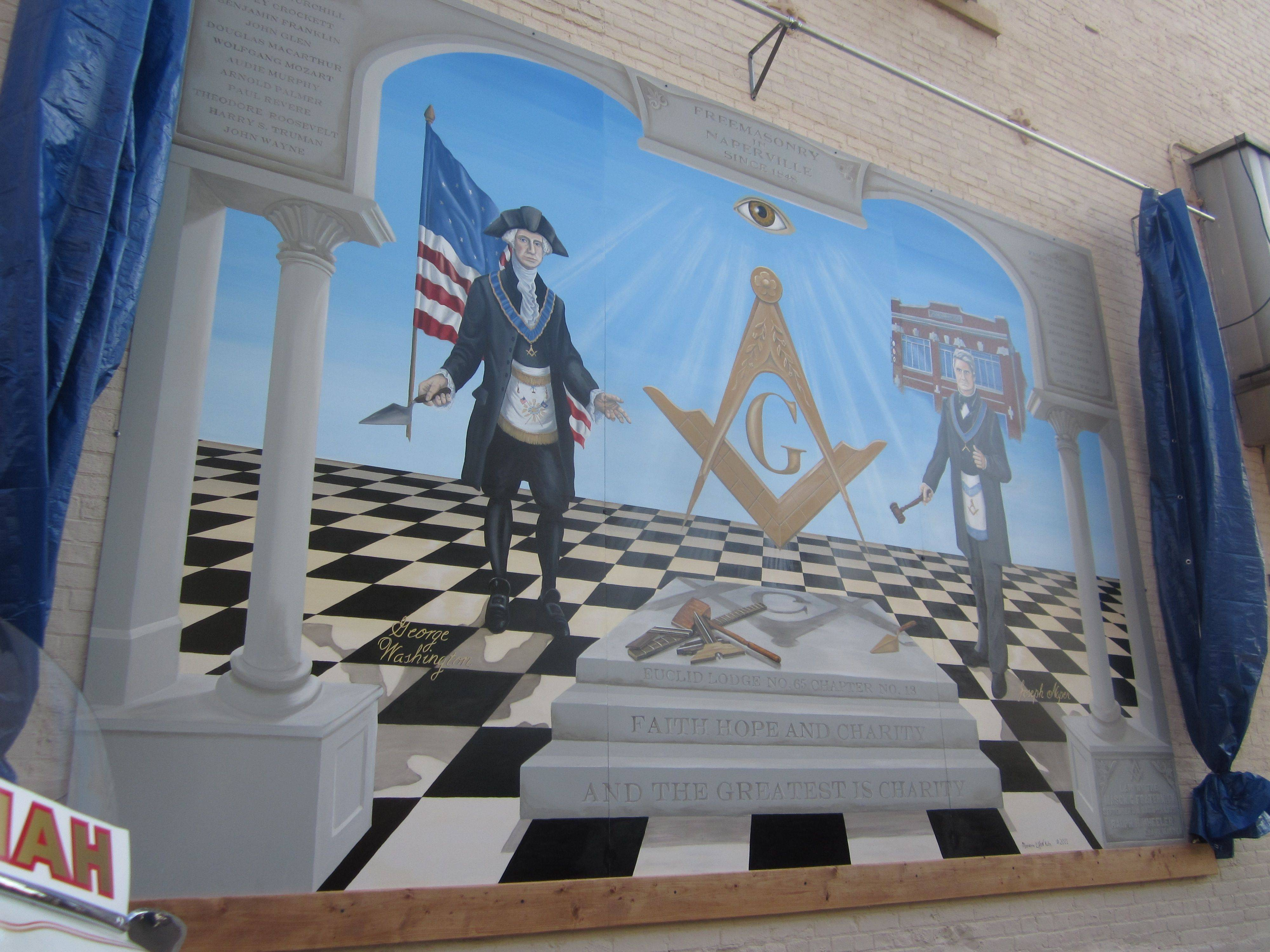 "Freemasons George Washington and Joseph Naper are shown along with masonic symbols like the all-seeing eye, a compass and masonry tools in Century Walk's newest piece of art, the mural ""Faith, Hope and Charity"" by Marianne Lisson-Kuhn. It was unveiled Saturday in Naperville."