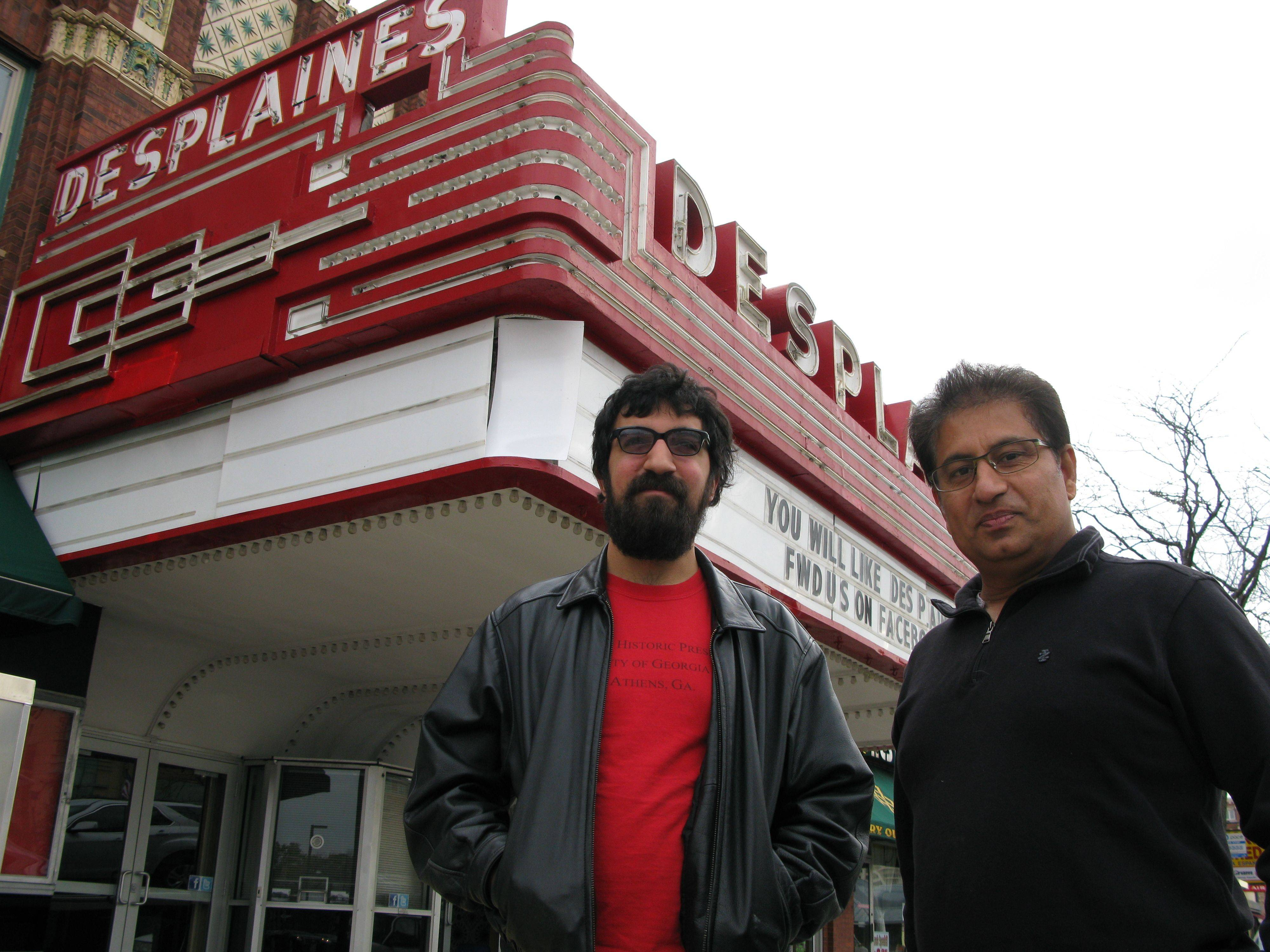 Des Plaines Theatre owner Dhitu Bhagwakar, right, and historical preservationist Brian Wolf stand in front of the newly restored and renovated theater, which reopens Nov. 11. Bhagwakar hopes the theater will take off with live performances, as well as Bollywood and Hollywood movie showings.
