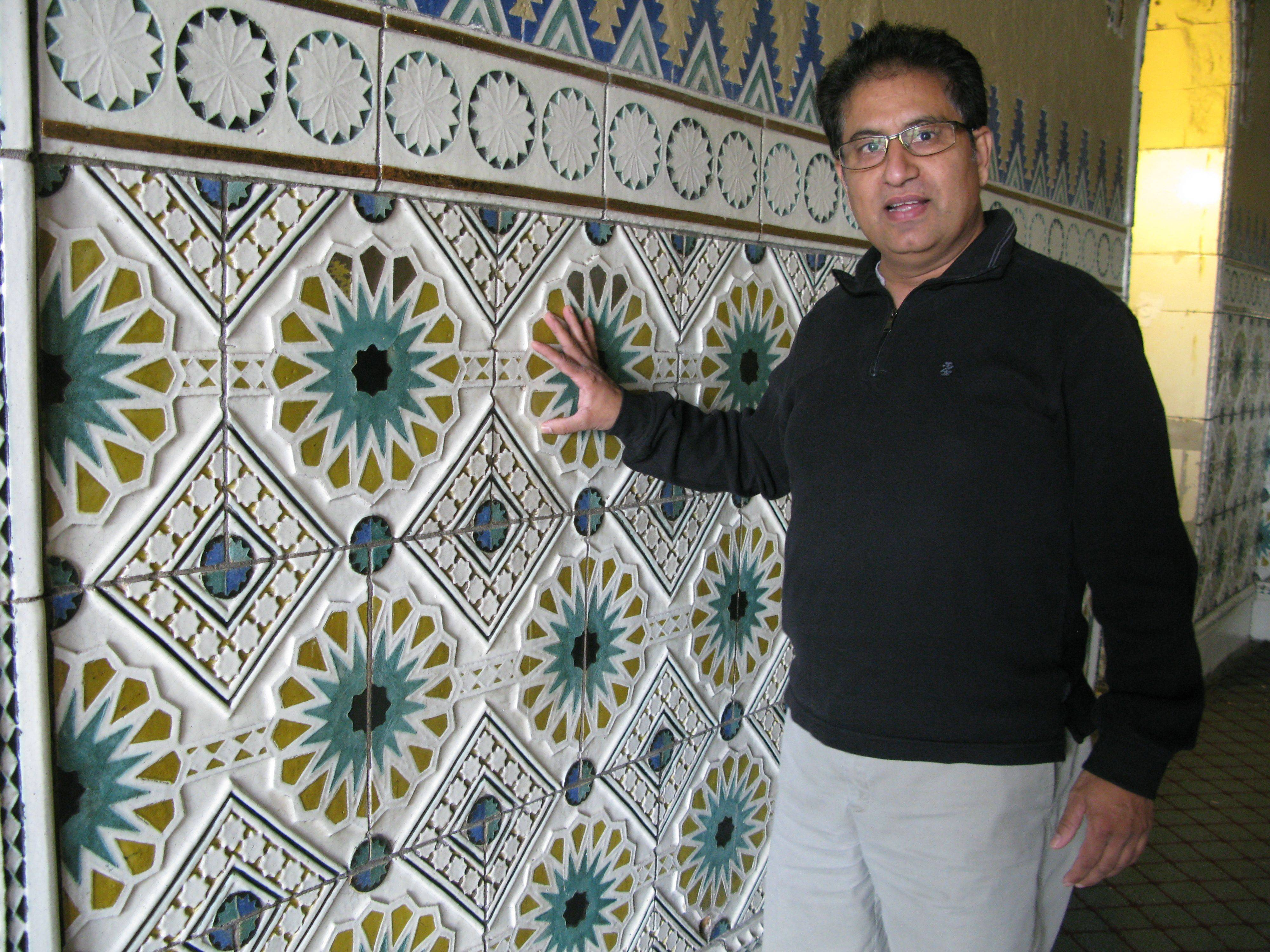 Des Plaines Theatre owner Dhitu Bhagwakar talks about the original terra cotta work that was uncovered underneath drywall and restored. The newly renovated downtown theater reopens Nov. 11 with live performances, as well as Bollywood and Hollywood movie showings.