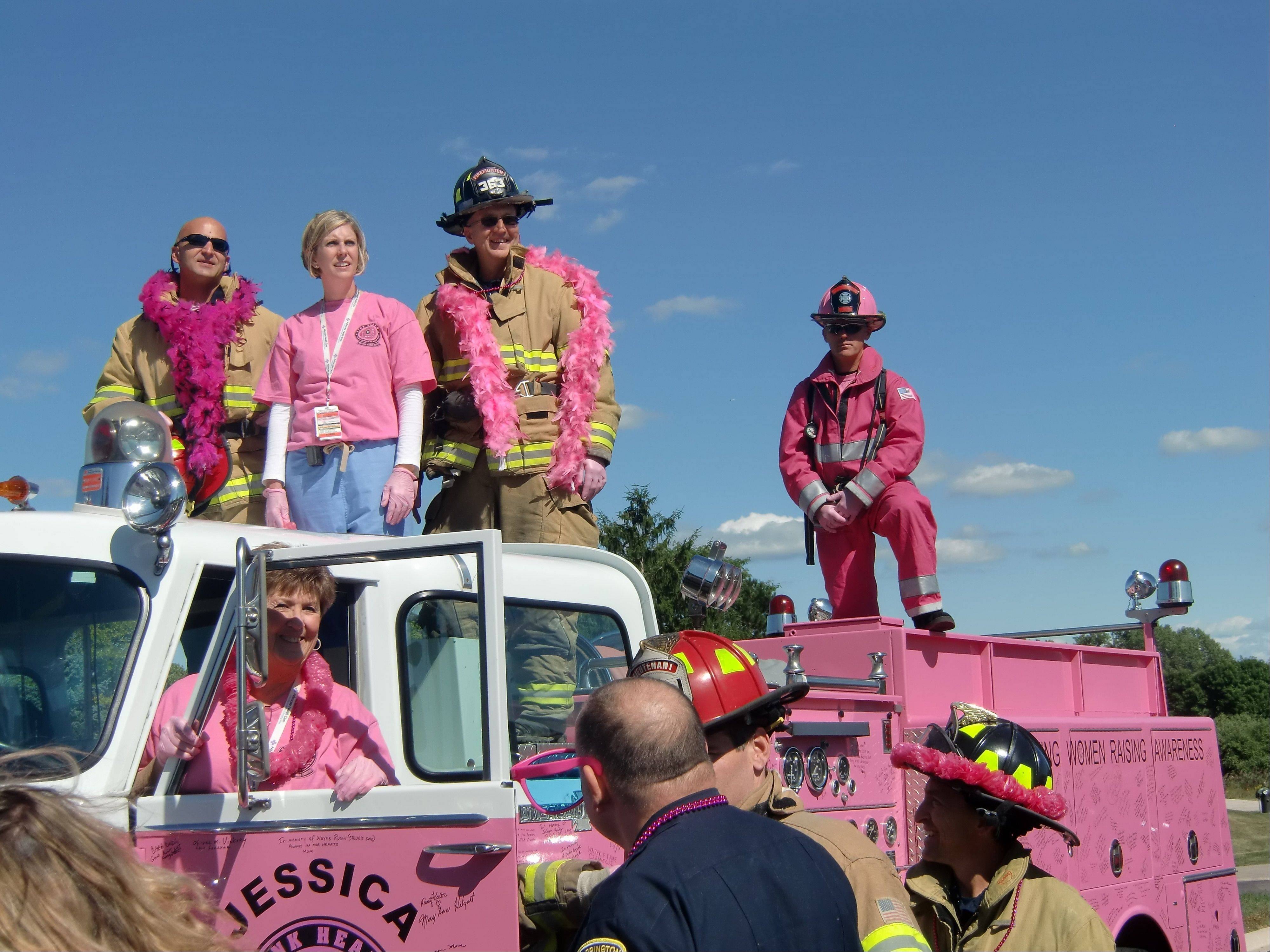 Emergency Medical Service personnel from Barrington and Lake Zurich participate in the taping of the video along with a pink fire engine named Jessica that's used to promote breast cancer awareness.