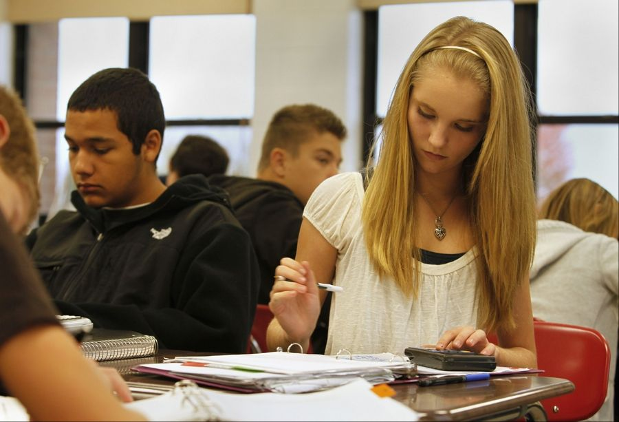 Jacobs sophomore Elizabeth Warner works out an algebra equation. Classmate Alec Morin is on her right.