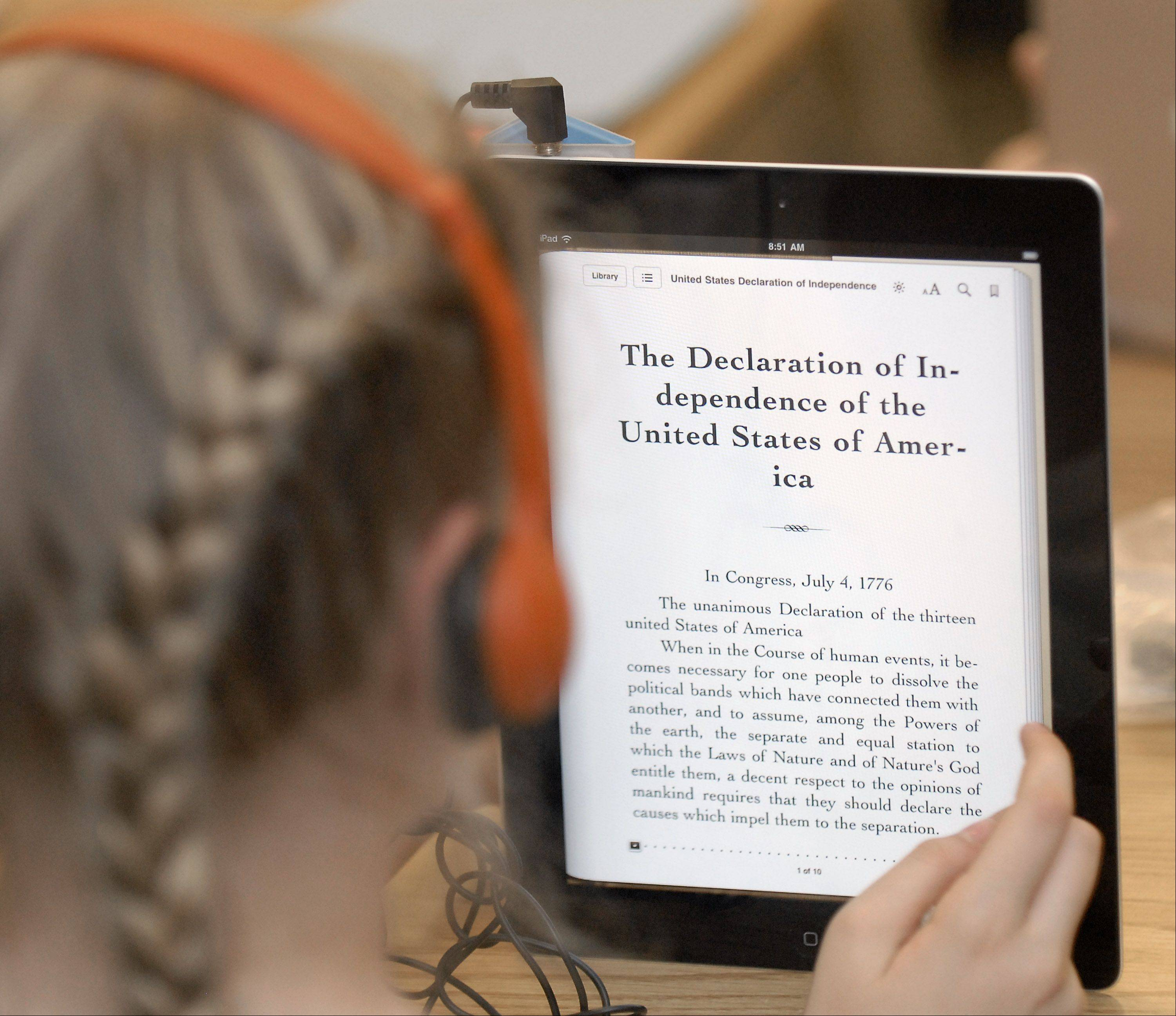 A fifth-grader uses her school-issued iPad during a reading enrichment period in Dena Leckbee's class at Richmond Intermediate School in St. Charles.