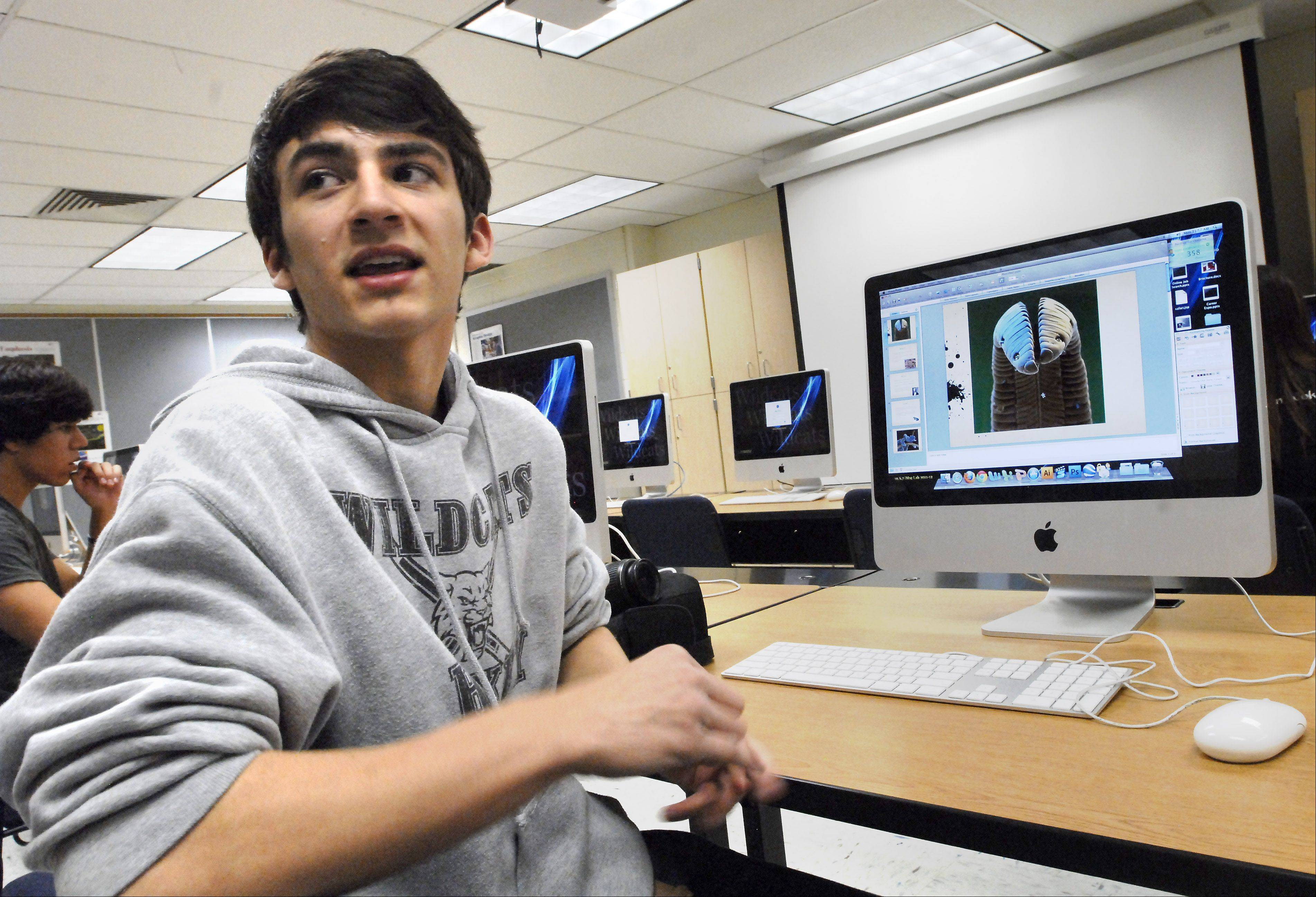 Wheeling High School sophomore Chris Kalama researches microphotography in the school's new digital photography lab.