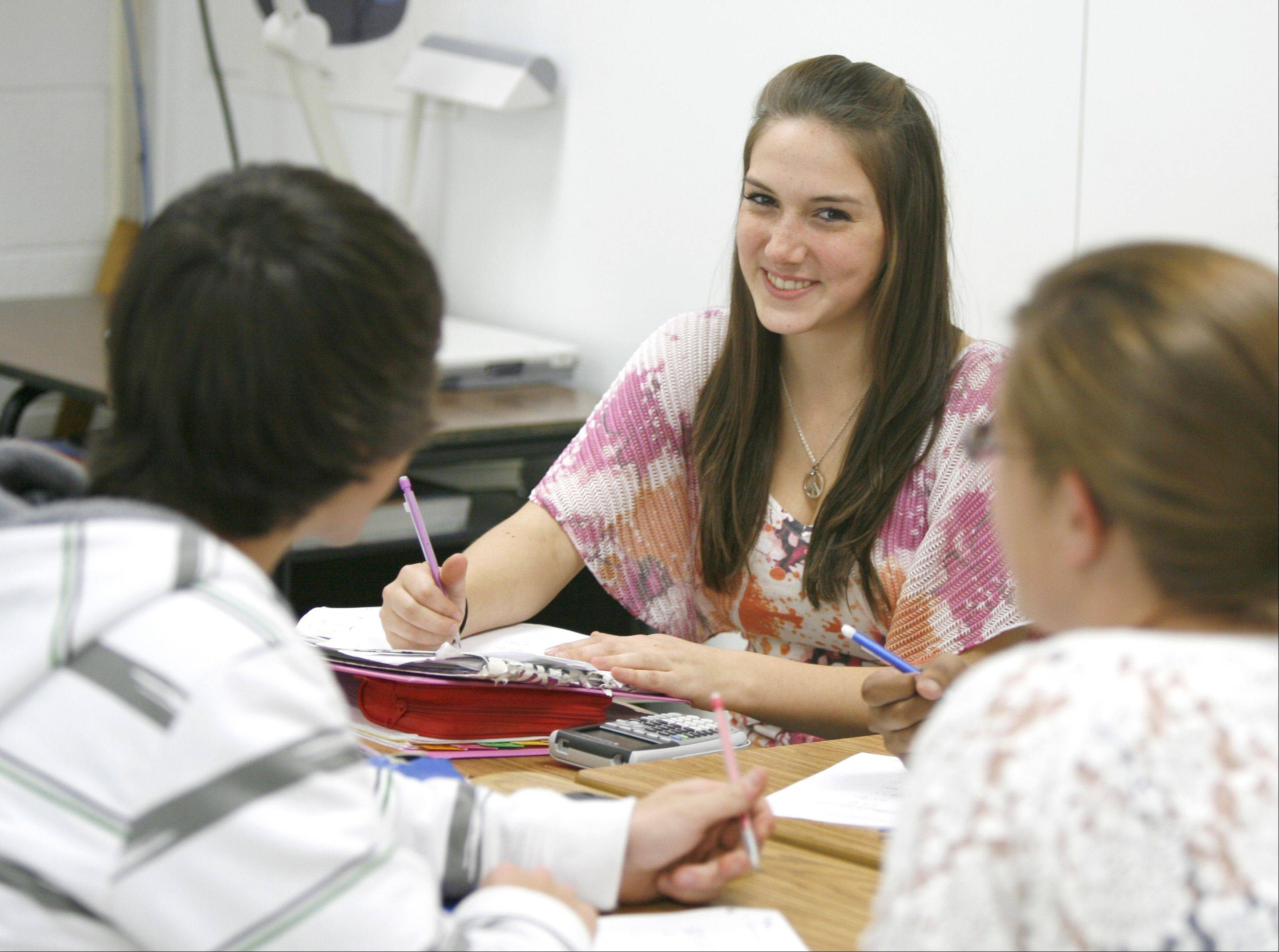 Rachel Birkley, center, solves a problem during Mike Coit's honors pre-calculus class at Lisle Senior High School, where average composite ACT scores jumped from 22.0 in 2010 to 23.1 this year.