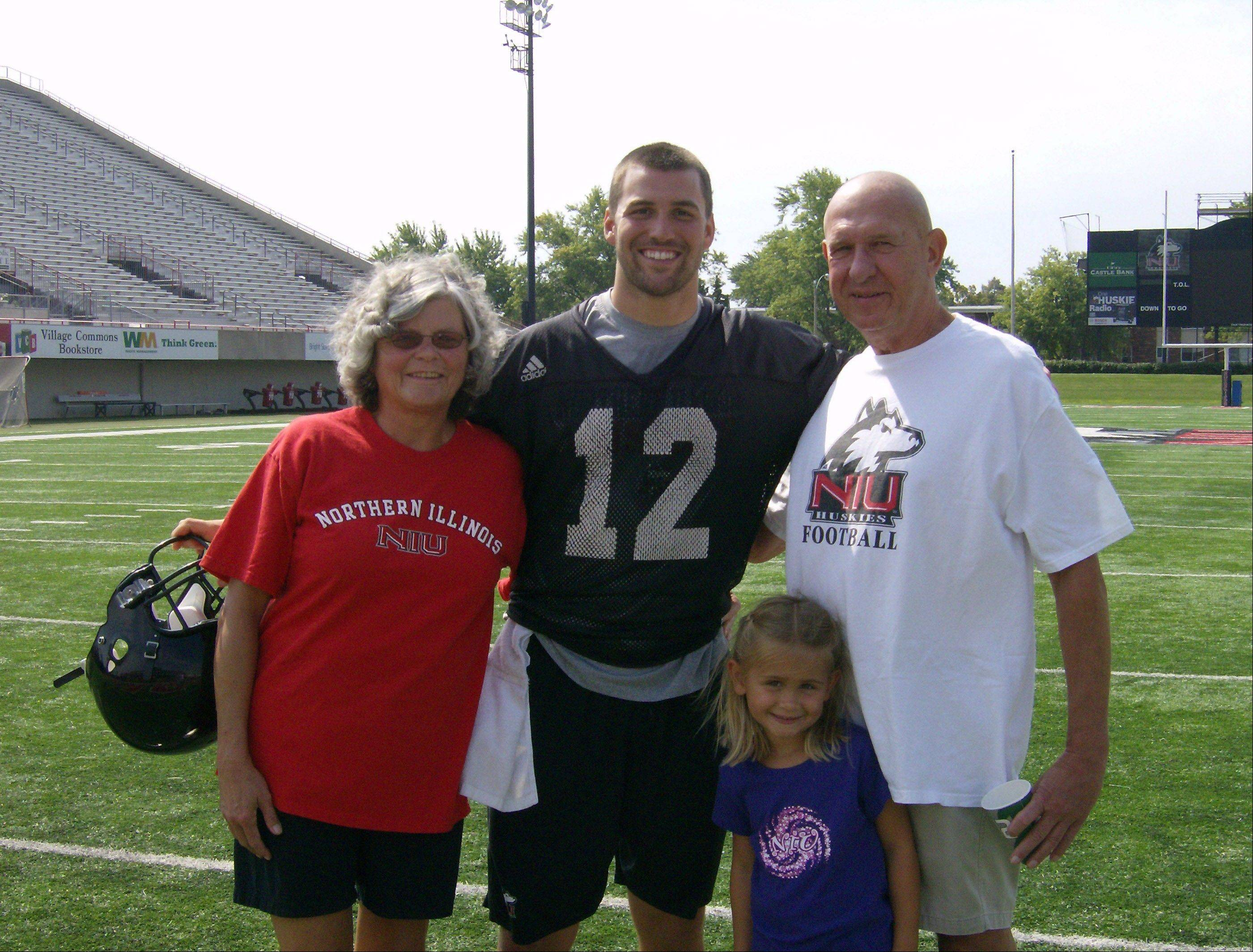 Former Northern Illinois All-American quarterback George Bork, right, with his wife, Merlin. and a granddaughter, were in DeKalb in August to meet Huskies quarterback Chandler Harnish, who is breaking most of the passing records Bork set in his career.
