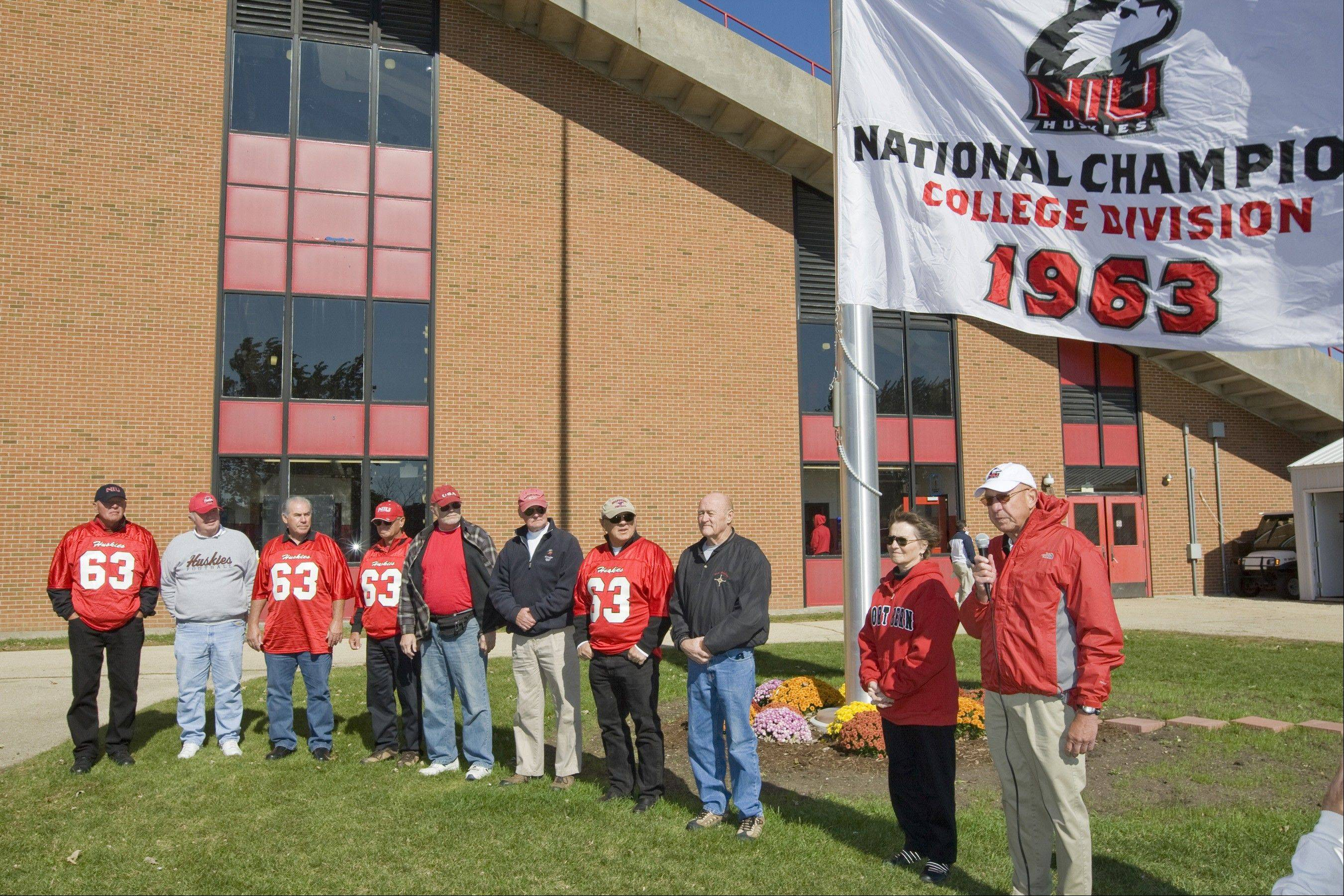 Legendary Northern Illinois quarterback George Bork and some of his 1963 teammates gathered last month for a flag poll dedication in their honor during NIU Homecoming activities.