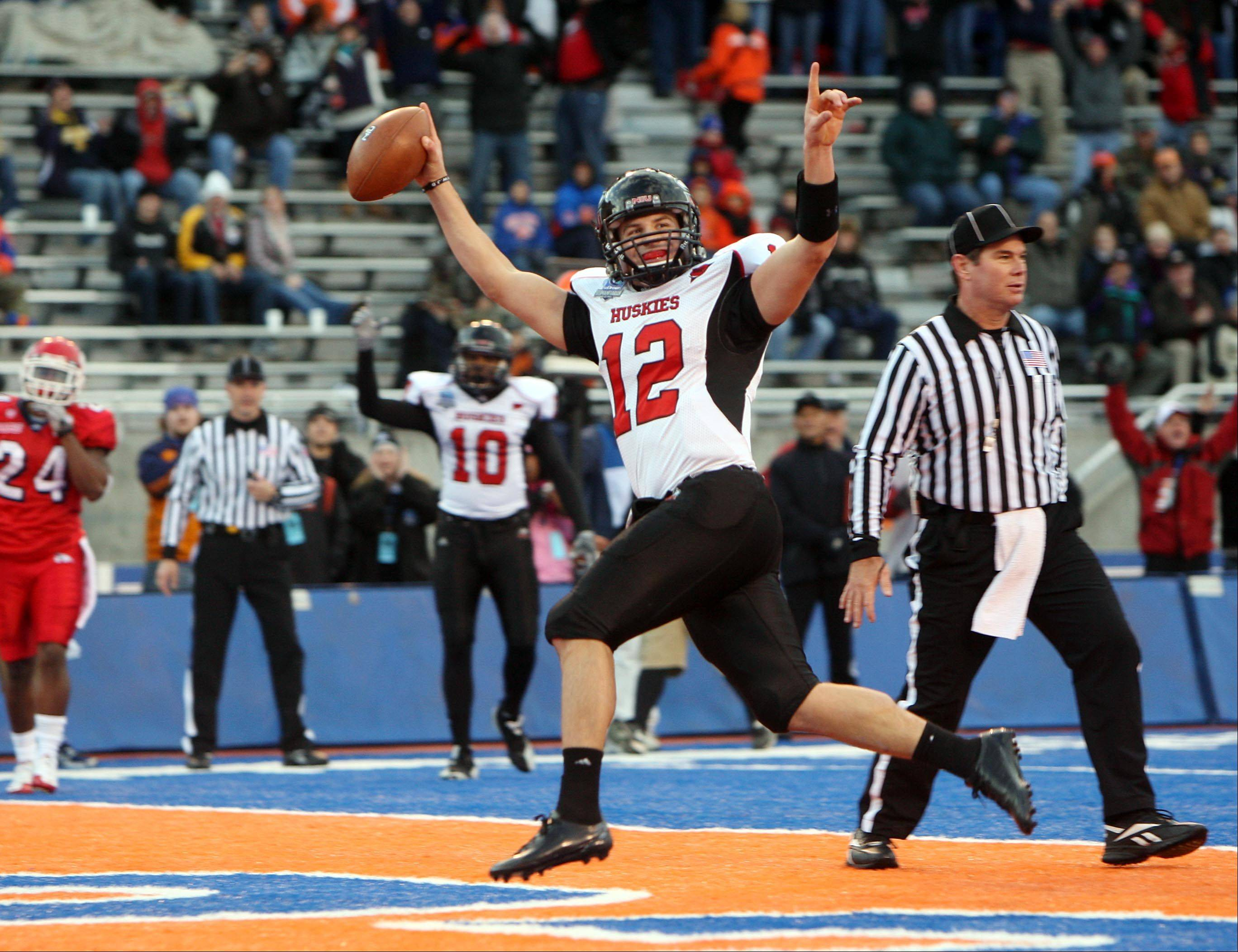 Northern Illinois quarterback Chandler Harnish (12) celebrates a first-half touchdown against Fresno State in the uDrove Humanitarian Bowl at Bronco Stadium, Saturday, Dec. 18, 2010, in Boise, Idaho.