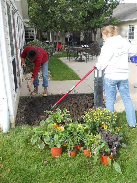 Conant students dig in to help elderly garden at Elk Grove home