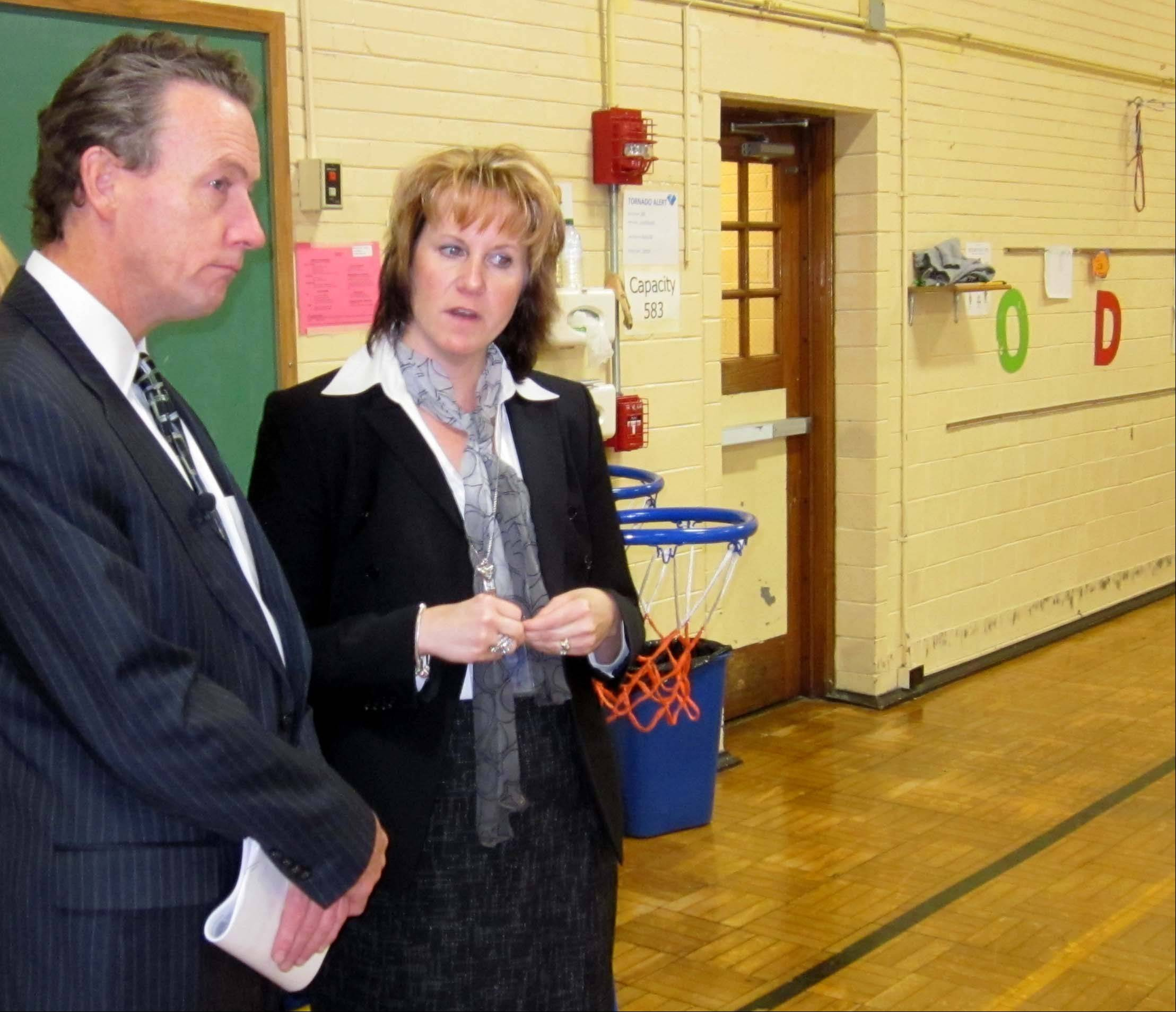 Peter Cunningham, U.S. $START_URL$Department of Education ;http://www.education.gov$STOP_URL$assistant secretary, discusses early learning standards with Todd Early Learning Center Principal Laurie Klomhaus, during a Tuesday visit.