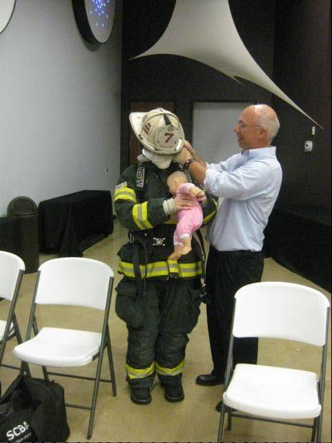 Palatine Rural Fire Protection District Battalion Chief Jeff Dill, founder of the Firefighter Behavioral Health Alliance, runs a tactical exercise simulating a baby's rescue so counselors can get an idea of what firefighters experience.