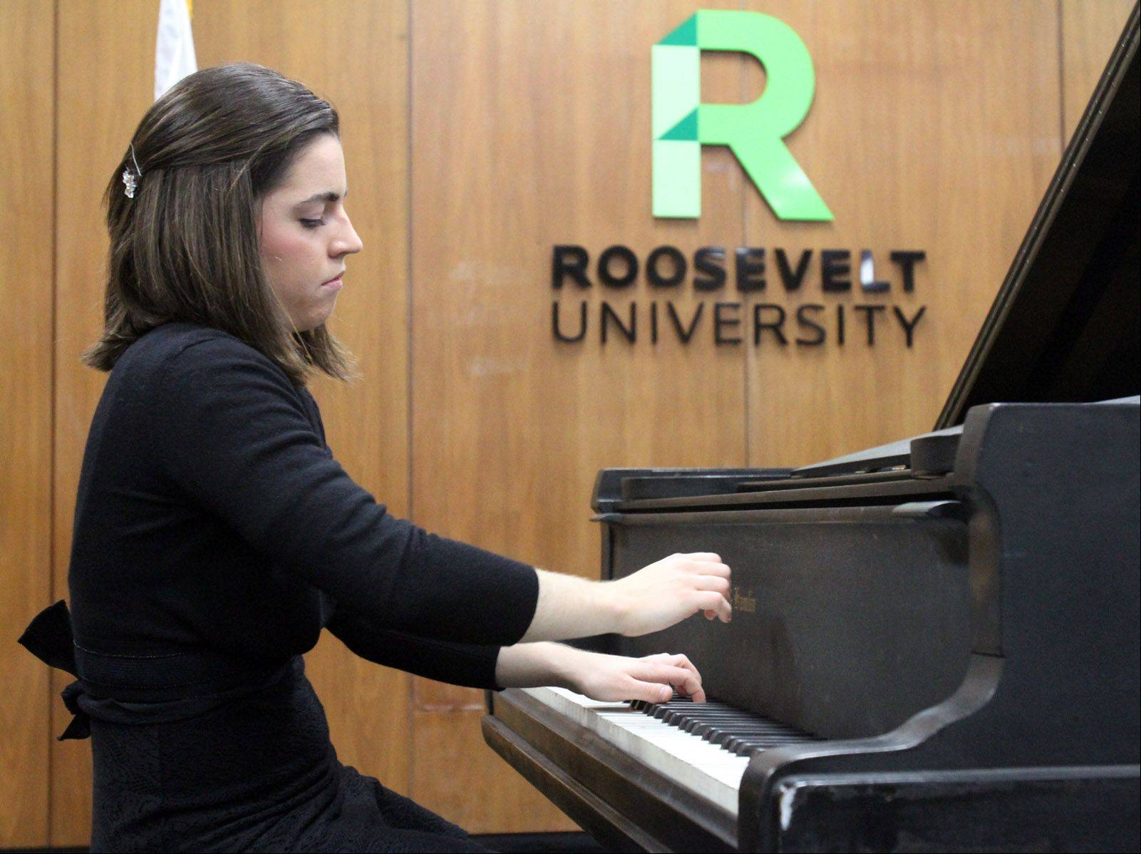 Enriqueta Somarriba, a Roosevelt University student born in Spain, plays Haydn Sonata in C major. She was among the award-winning pianists from Roosevelt's College of Performing Arts to perform in a piano showcase recital at the university's Schaumburg campus Tuesday.
