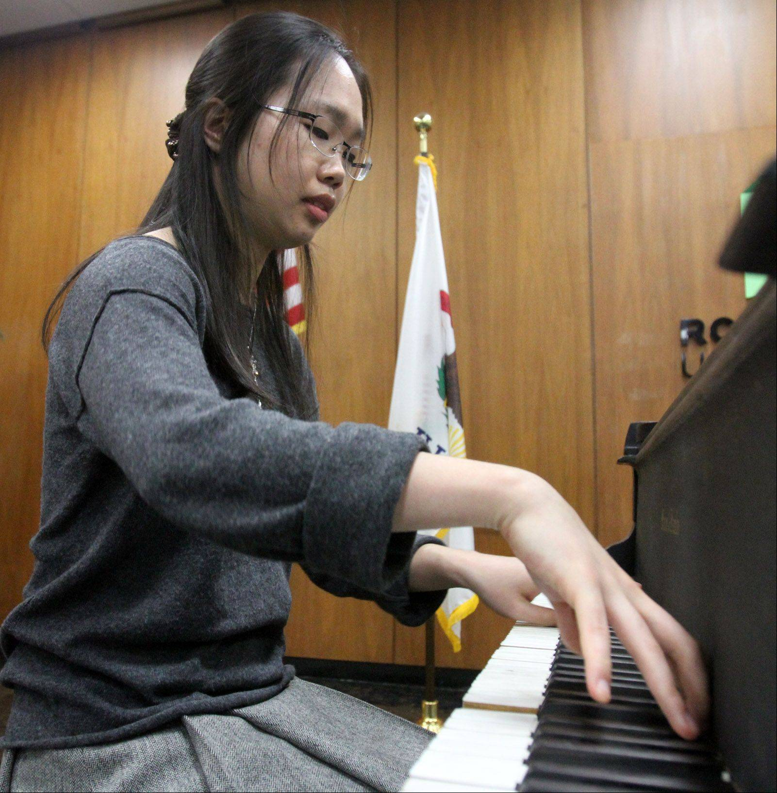 Roosevelt University student Chanmi Ryu plays Bach Prelude and Fugue in F major. Award-winning pianists from Roosevelt's College of Performing Arts performed in a piano showcase recital at the university's Schaumburg campus Tuesday.