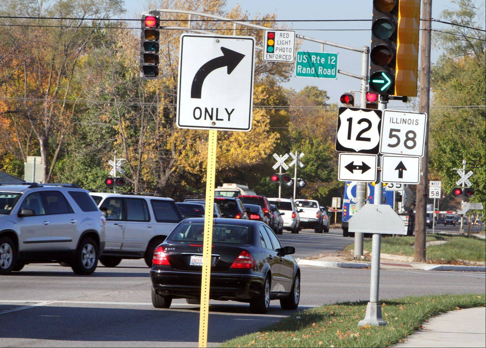 Des Plaines police want to collect more data on red-light cameras at the intersection of Golf and Rand roads that have been in place for a year. Crashes at that intersection went up, though they were minor in nature, police say.