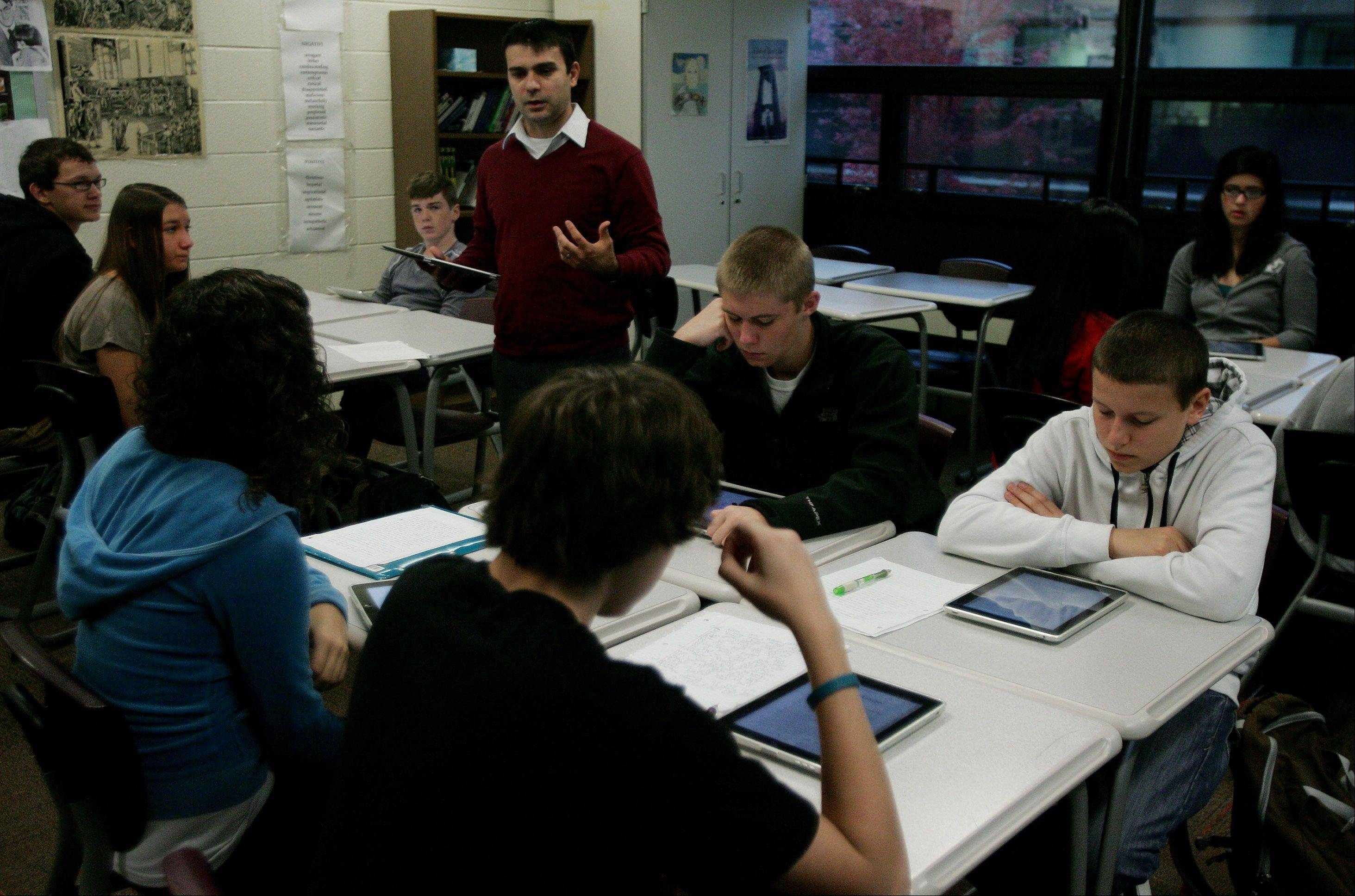 Sophomore English teacher Joseph Geocaris talks while students use iPads in a Stevenson High School class that includes special education students and regular students.