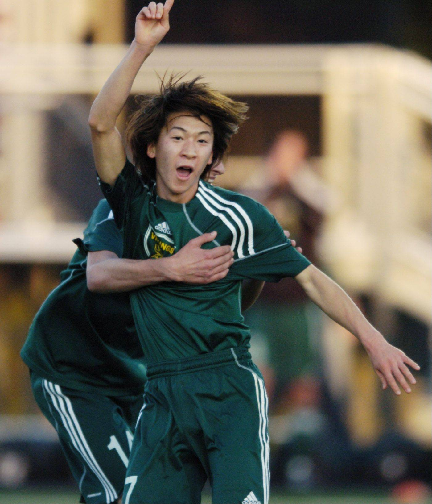 Fremd's Yusuke Kanada celebrates his goal against New Trier during Tuesday's boys soccer supersectional game at Maine South.