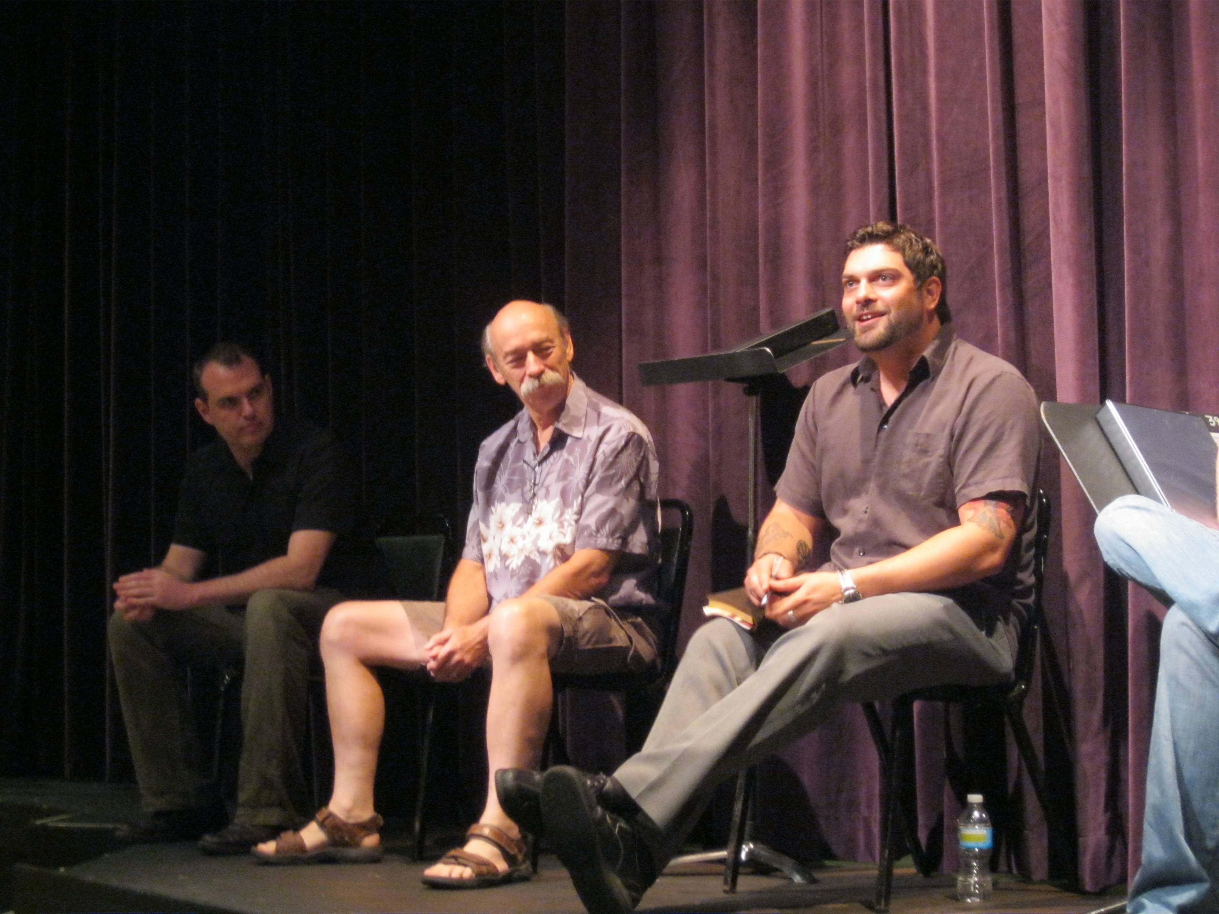 Playwright K. Frithjof Peterson of Michigan participates with Scientist Bruce Worthel of Fermilab and artistic director John Gawlik in a group discussion about his play development with patrons during the Inaugural Collider 2011 this past July.