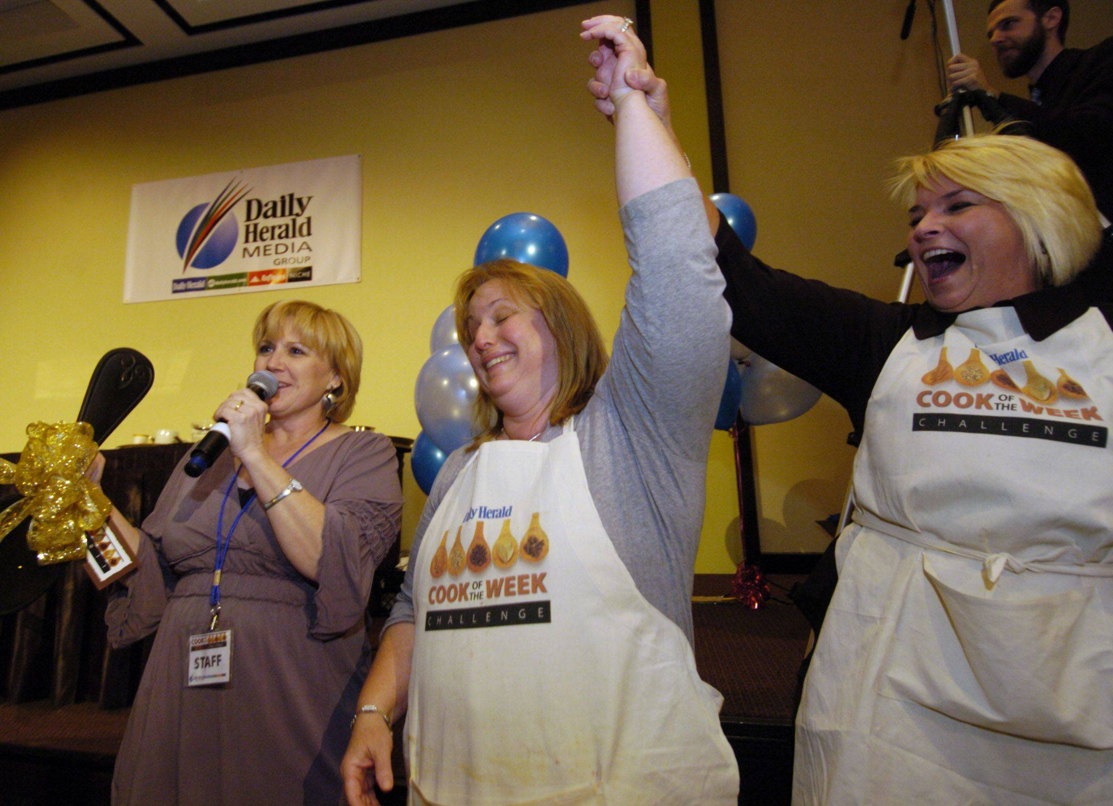 Penny Kazmier, center, with second-place finisher Cate Brusenbach, right, and Daily Herald Food Editor Deb Pankey, left, is the winner of the Cook of the Week Challenge.