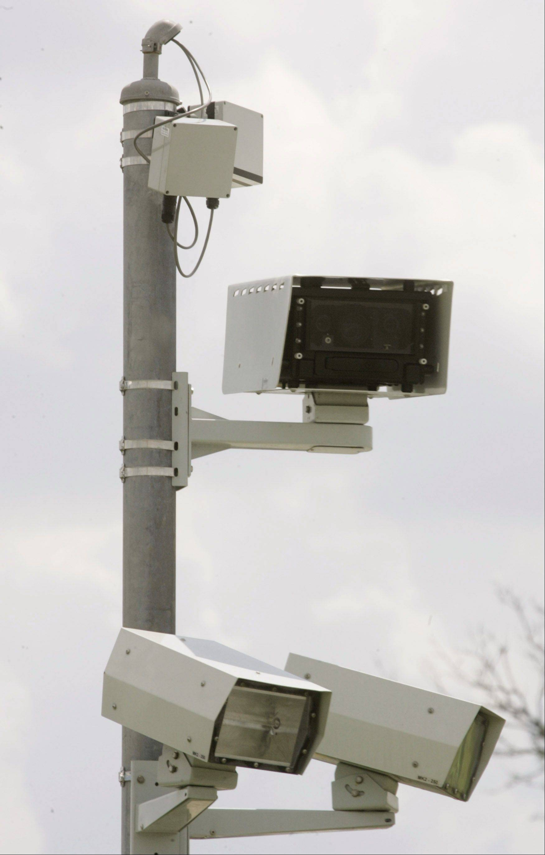 Naperville's red-light camera's, like this one at Route 59 and North Aurora Road will be deactivated effective Jan. 3 2012.