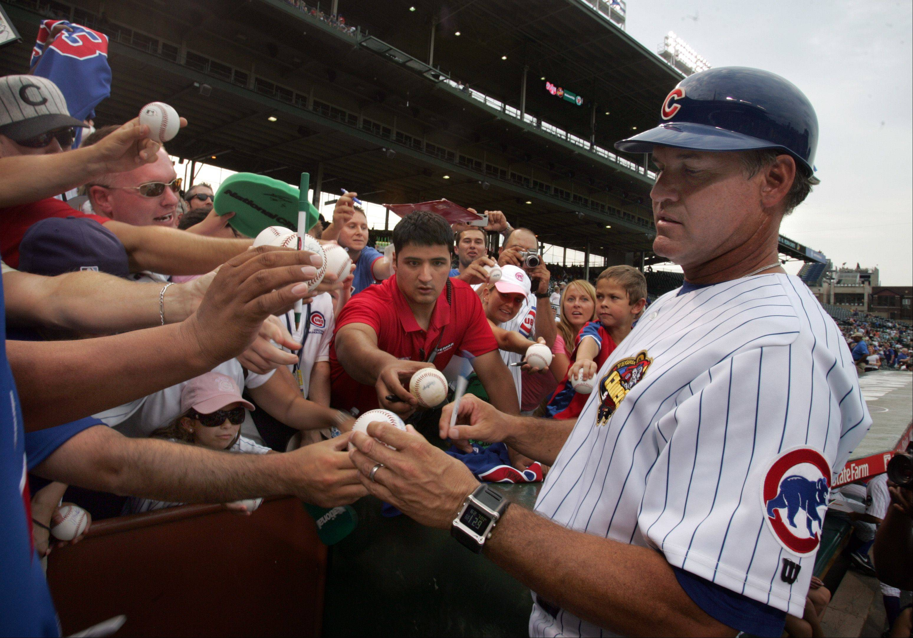 Ryne Sandberg former Chicago Cub star and hall of fame player and now manager of the Peoria Chefs signs autographs at Wrigley Field. His team is playing against Kane County Cougars.