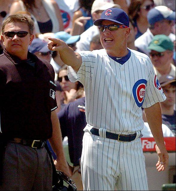Mike Quade discusses a call with home plate umpire duringa game against the Yankees at Wrigley Field.