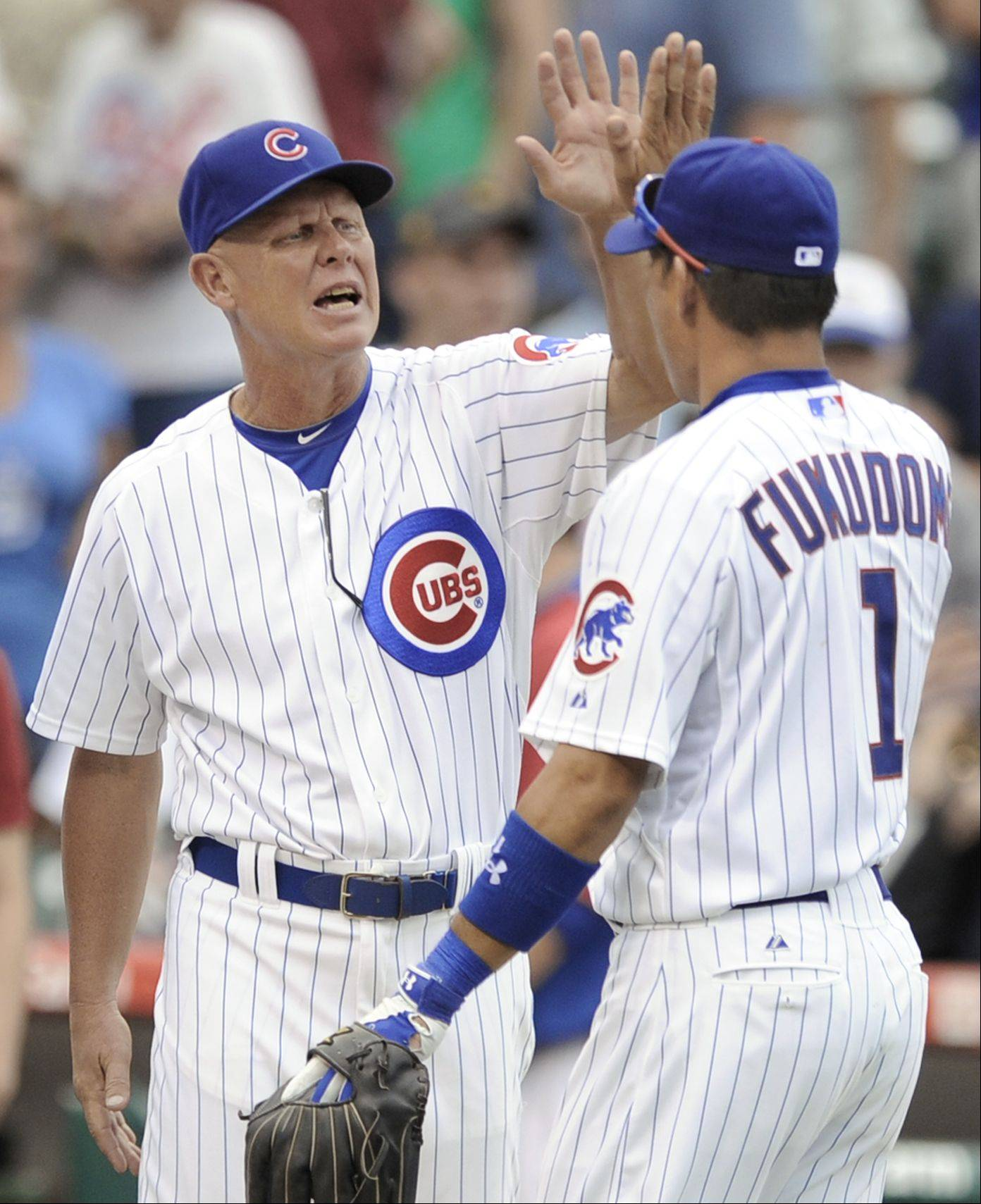 Chicago Cubs manager Mike Quade left, high-fives Kosuke Fukudome after the Cubs defeated the Pittsburgh Pirates 5-3 in a baseball game in Chicago, Wednesday, Sept. 1, 2010.
