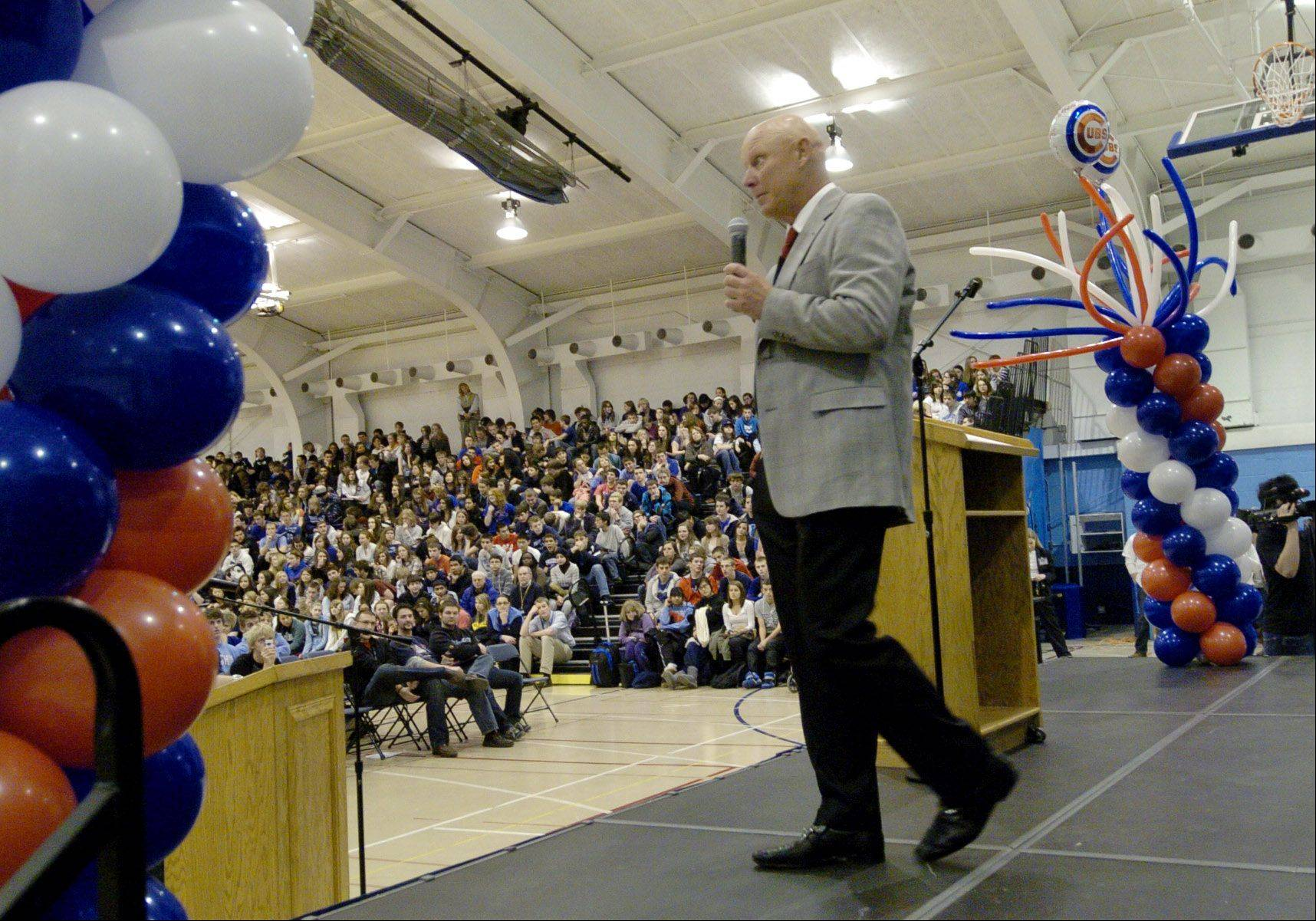 Cubs manager Mike Quade speaks at an assembly during his visit to his old high school, Prospect High.
