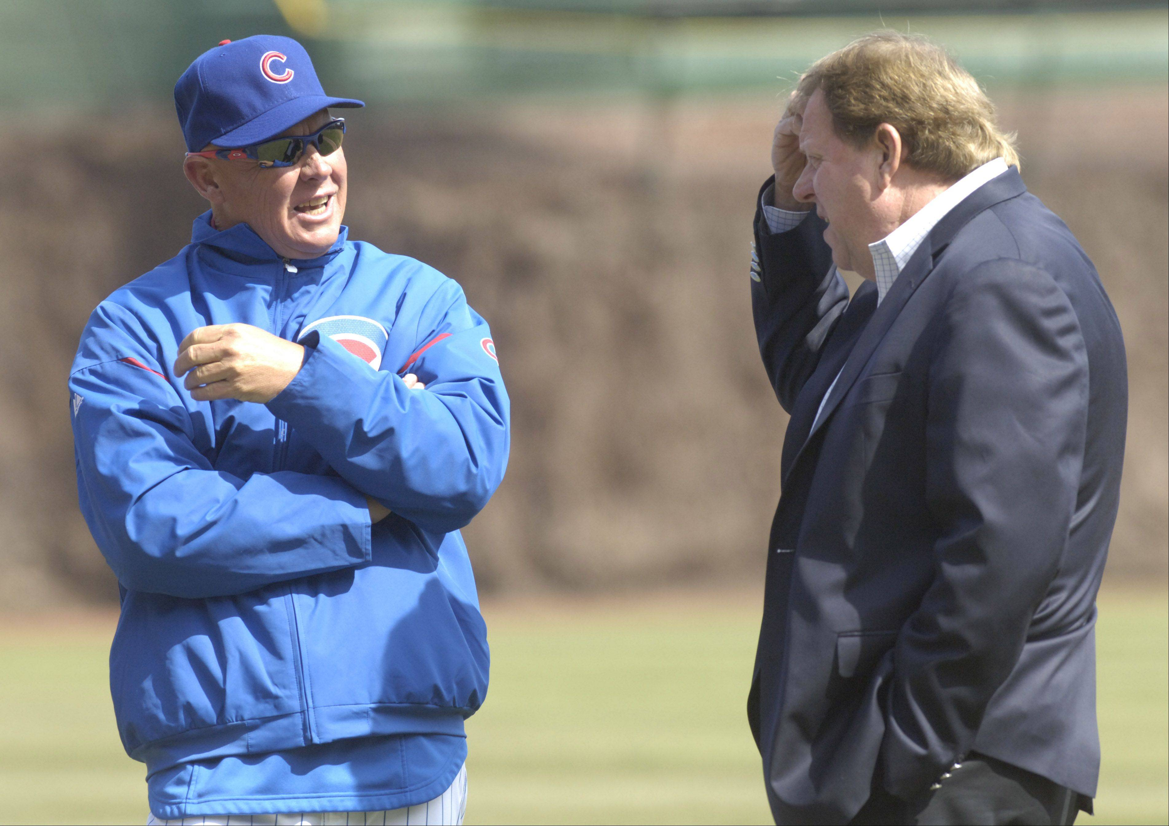 Cubs Manager Mike Quade talks with General Manager Jim Hendry prior to a team workout at Wrigley Field.