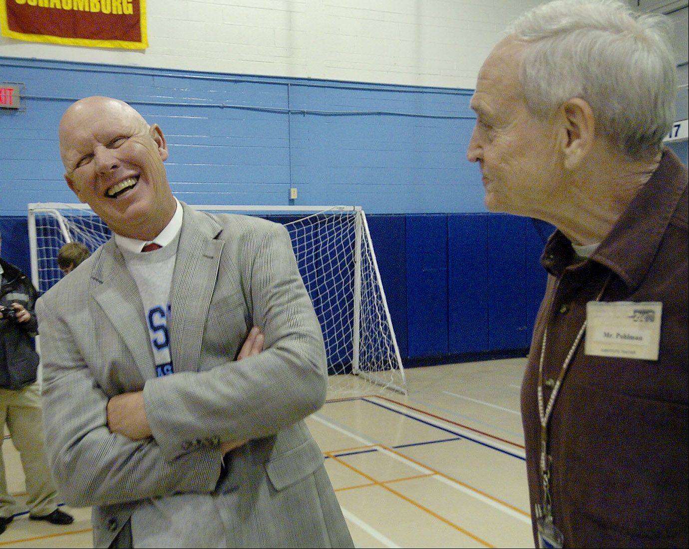 Cubs manager Mike Quade talks with his old baseball coach Larry Pohlman during his visit to his Alma Mater, Prospect High.
